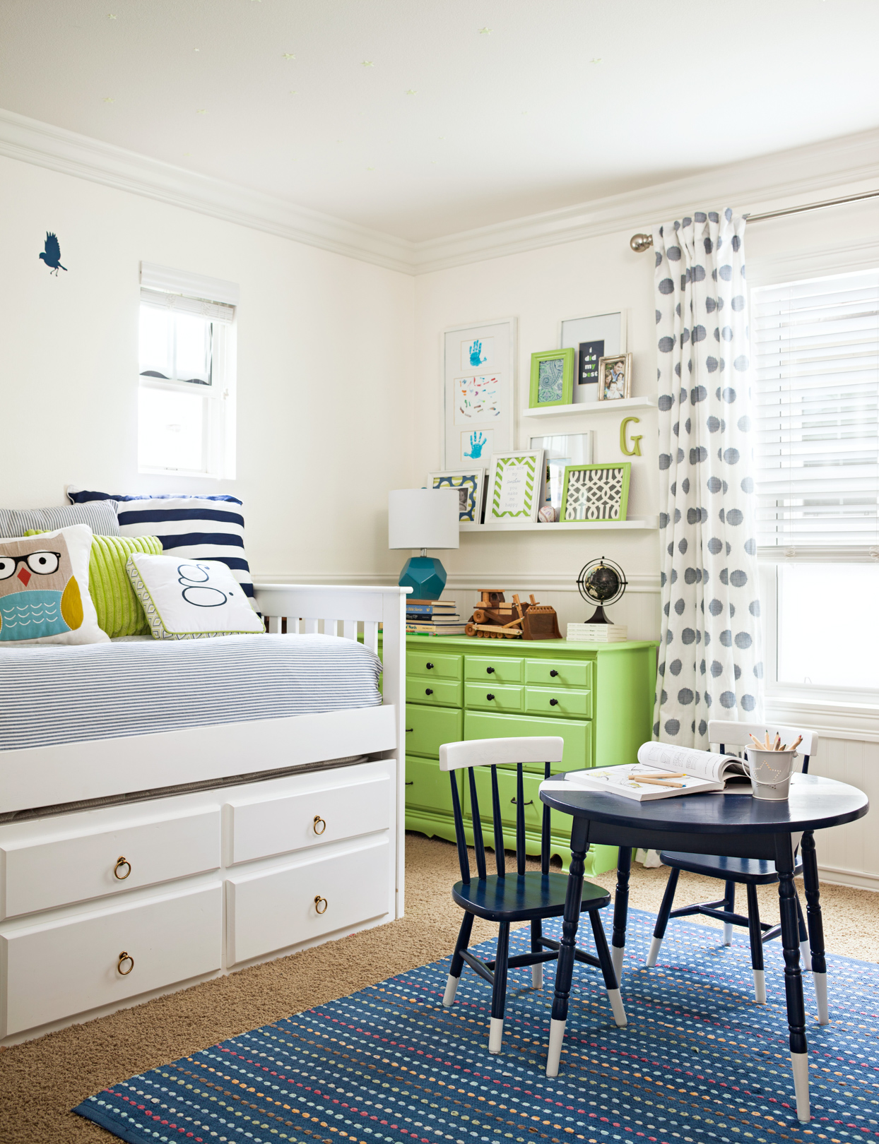 childrens bedroom with white green and blue décor