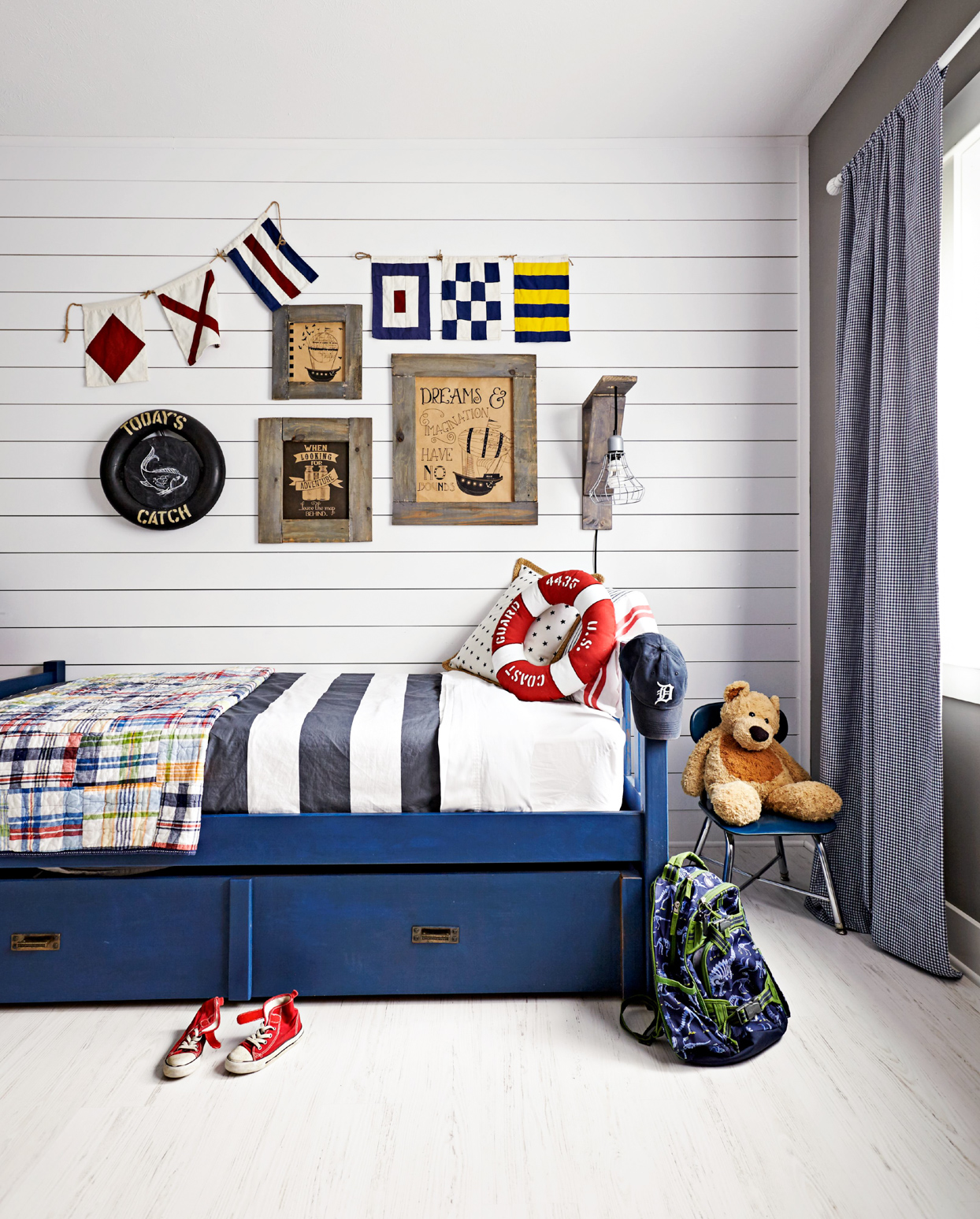 childrens bedroom white walls and nautical decor