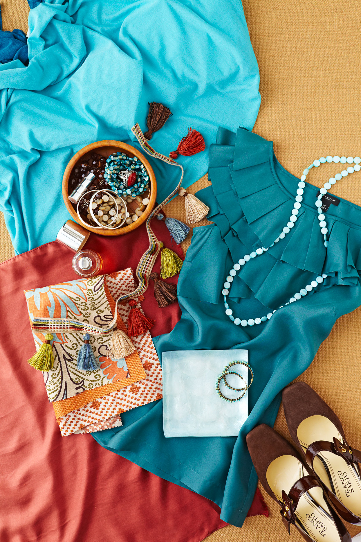 Teal blouse with colorful jewelry
