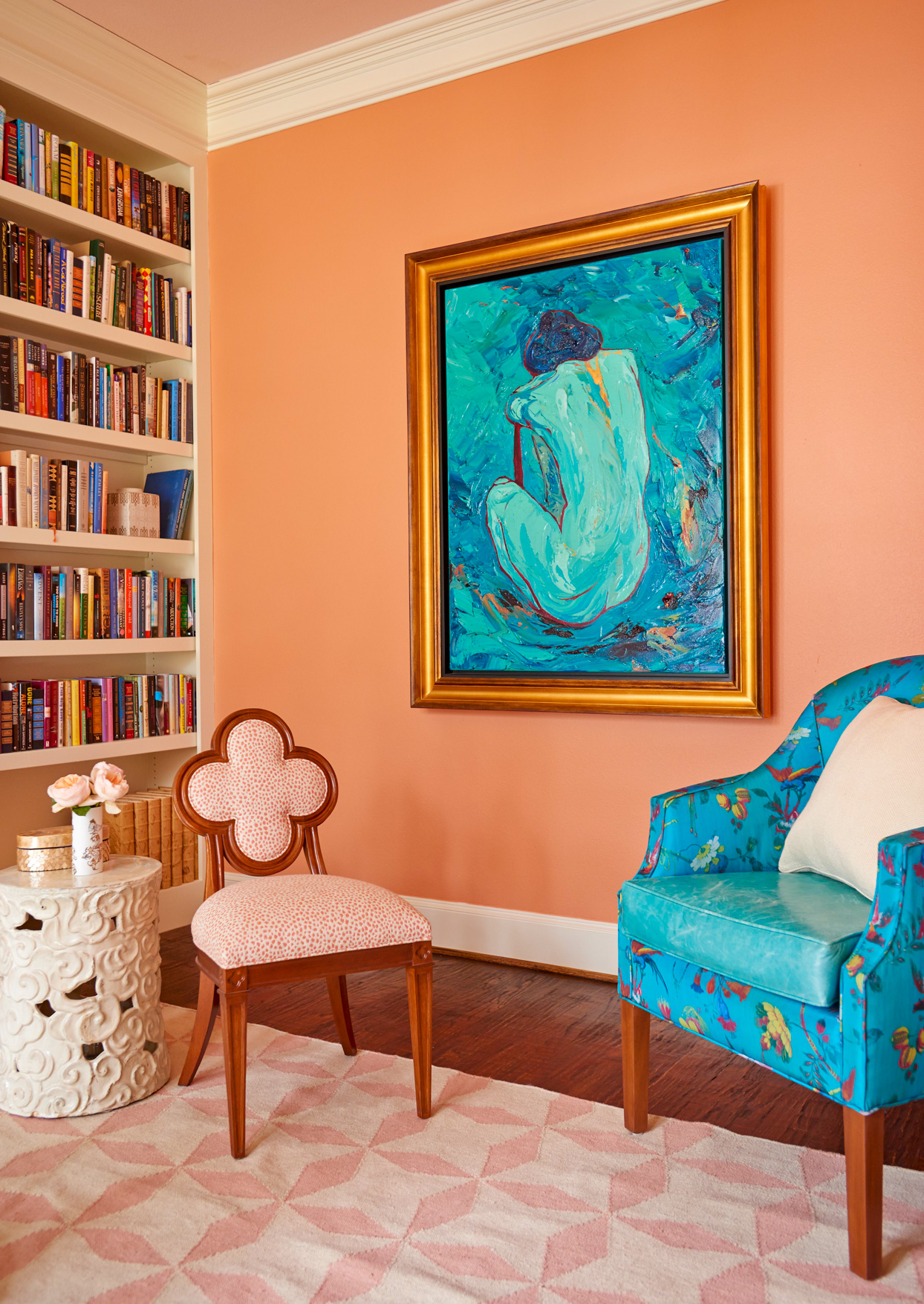 orange sitting room with blue painting and chair