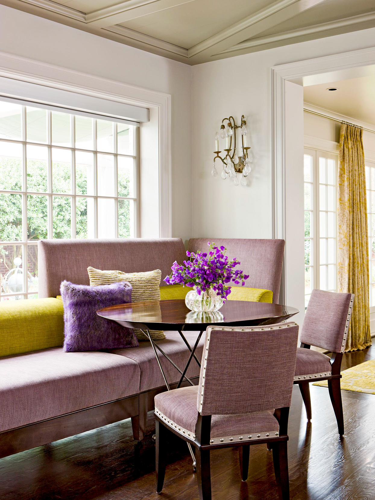 purple and gold dining room with chaise lounge