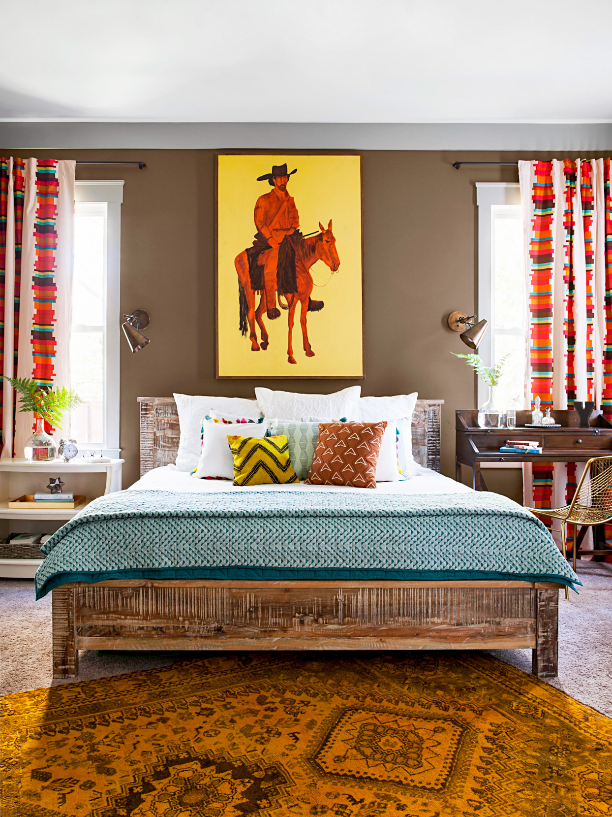 spanish style bedroom with red and blue décor