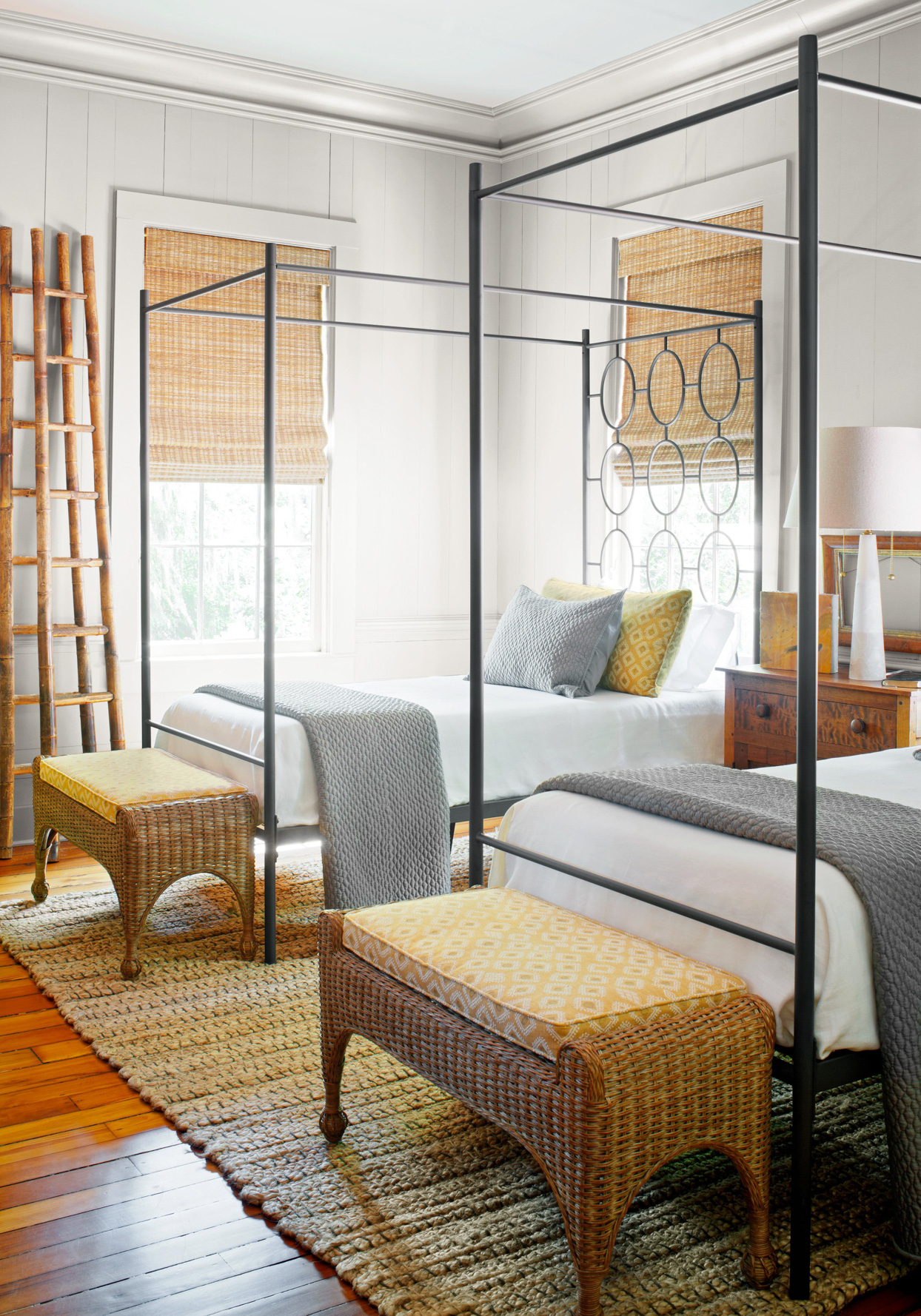 Twin canopy beds in bedroom