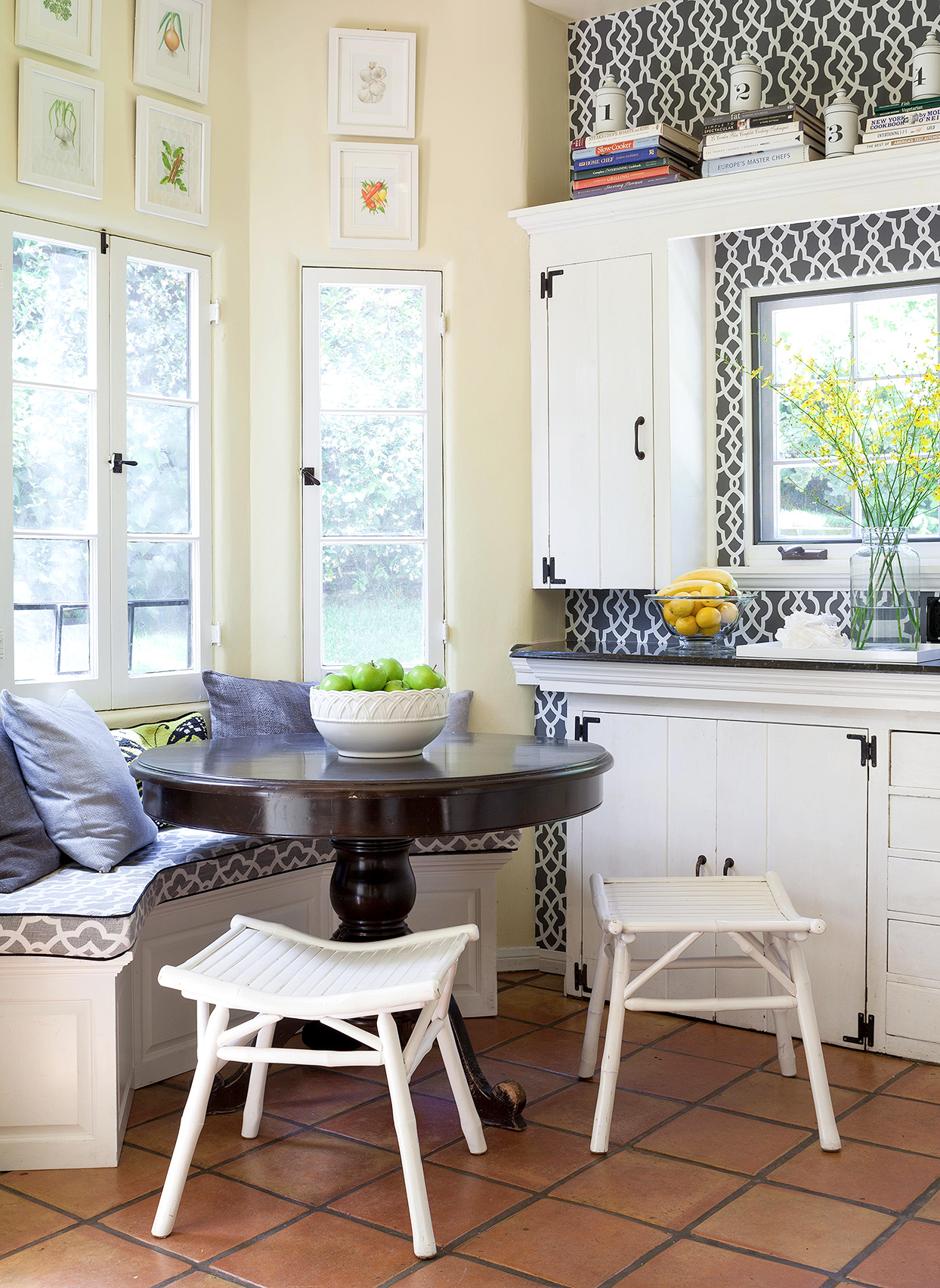 small breakfast nook pale yellow walls blue patterned wallpaper