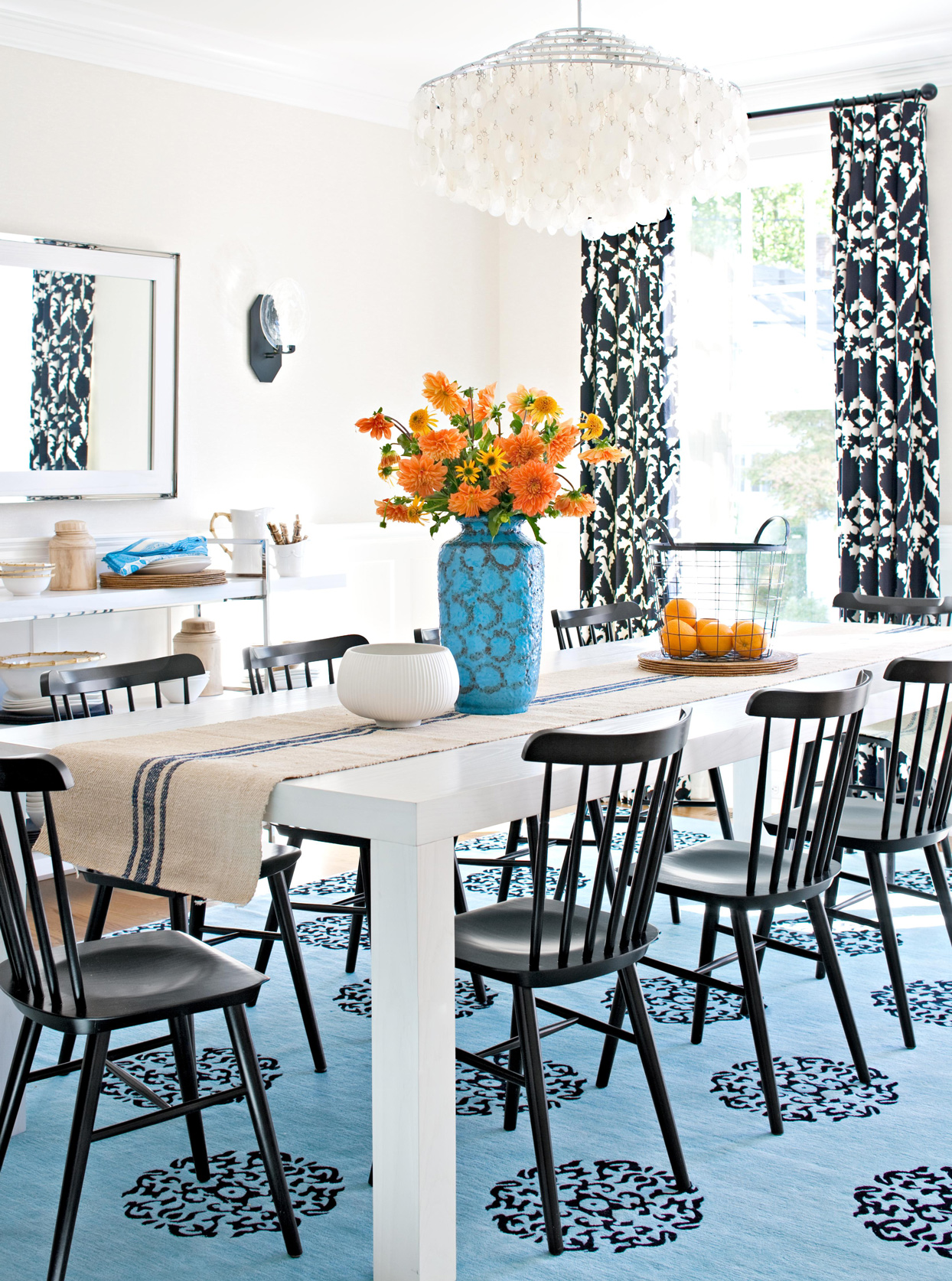 black and white dining table with blue black pattern space rug