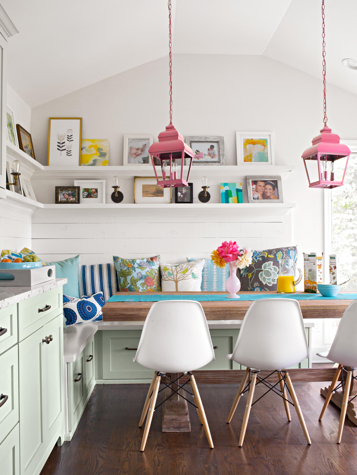 cottage style farmhouse table white walls pale green cabinets