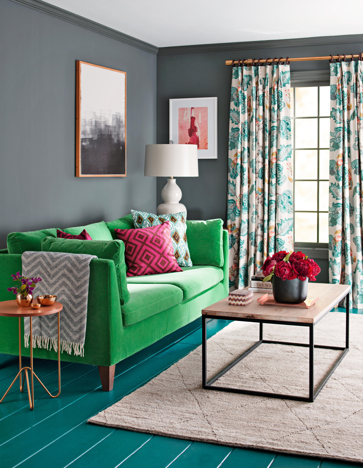 Dark gray wall living room with green couch
