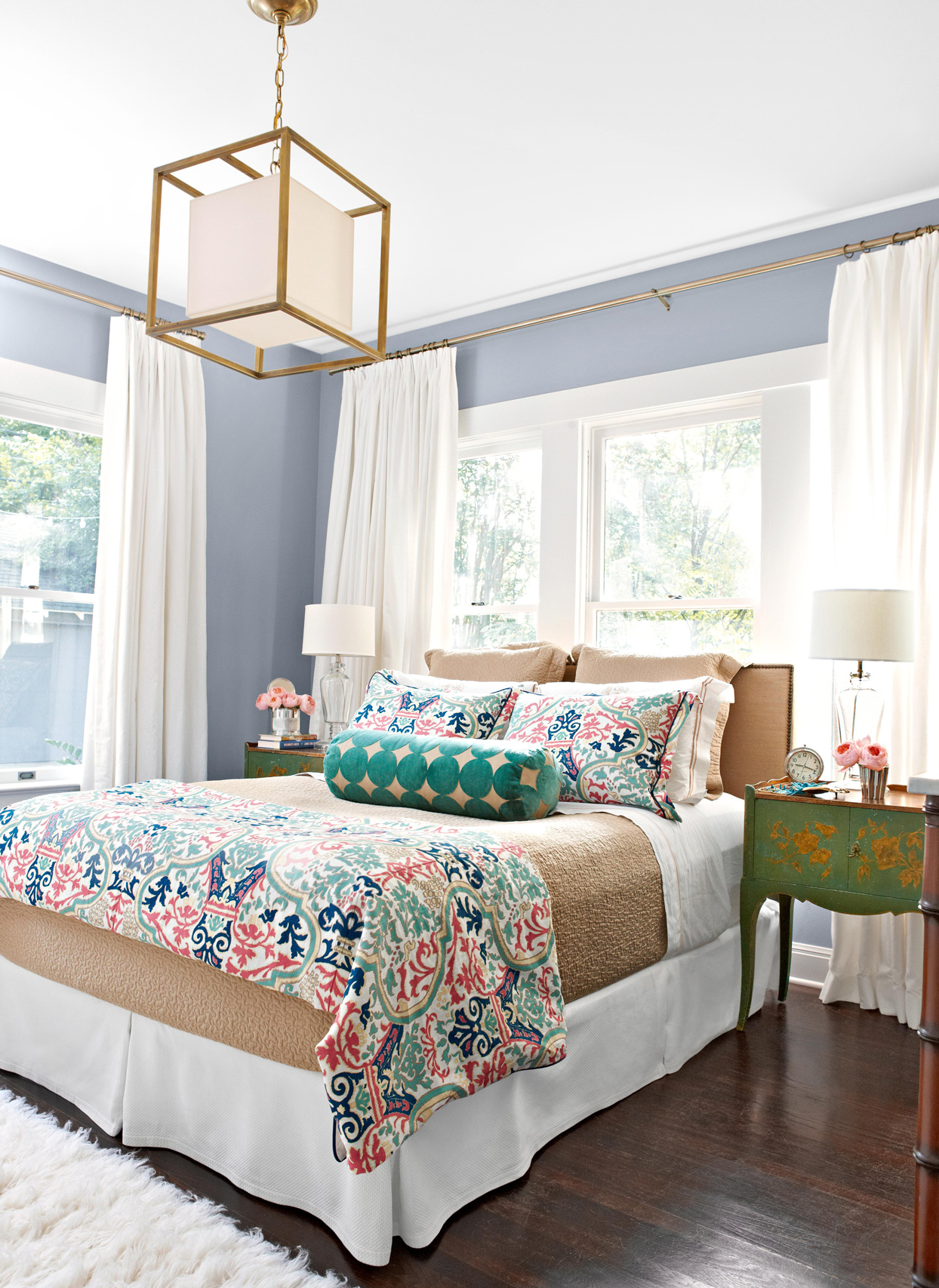 blue wall bedroom with square glass pendant decorative pattern bedding