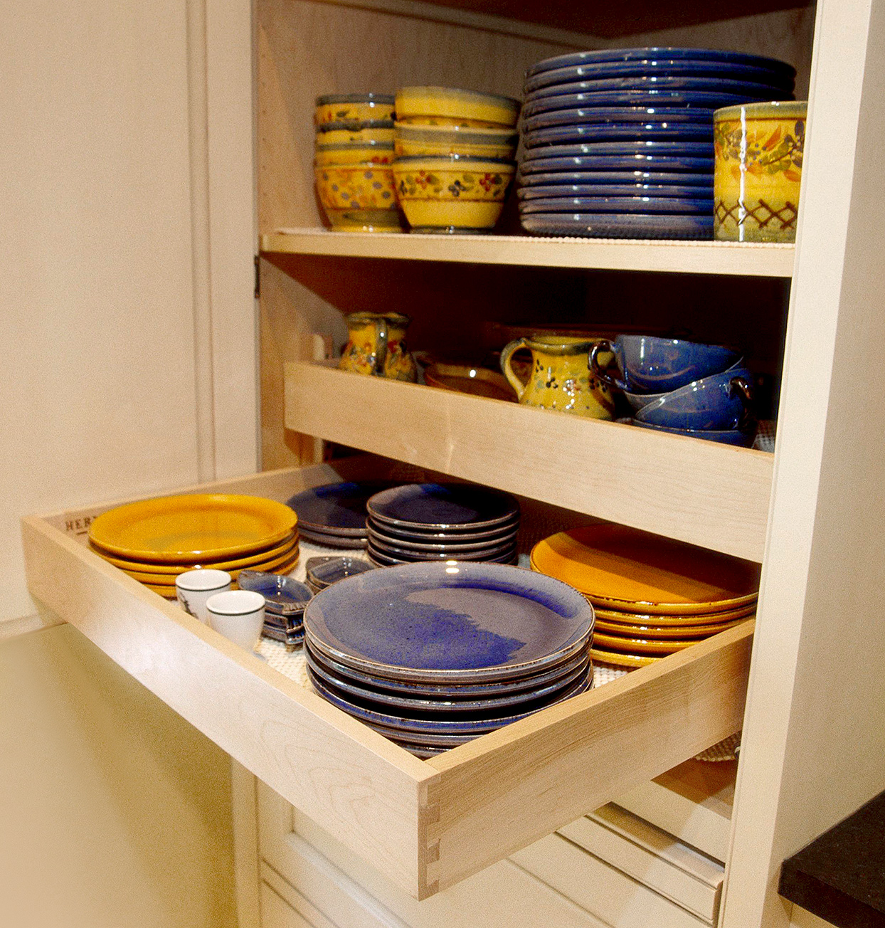 full extension kitchen cabinet drawer with plates and cups