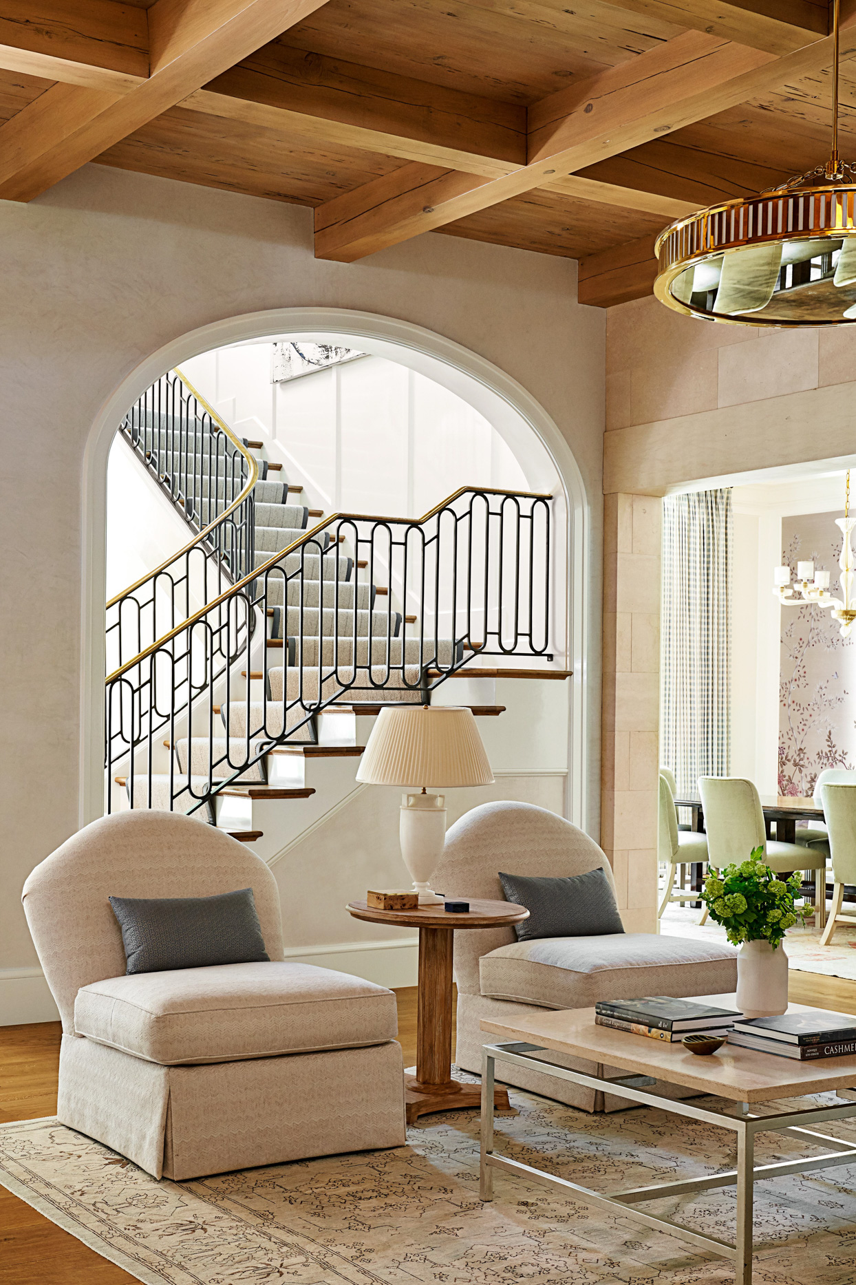 traditional neutral sitting area staircase arched doorways