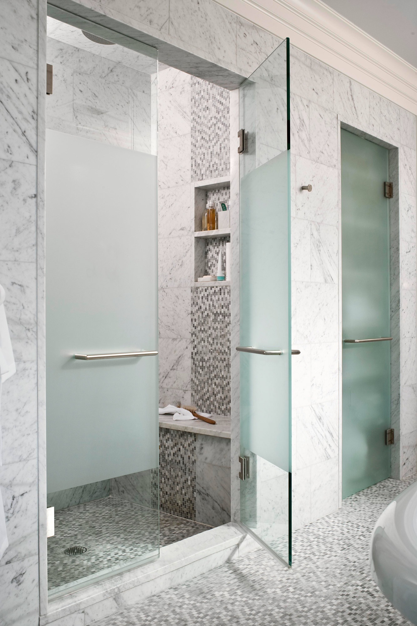 shower with frosted glass double doors