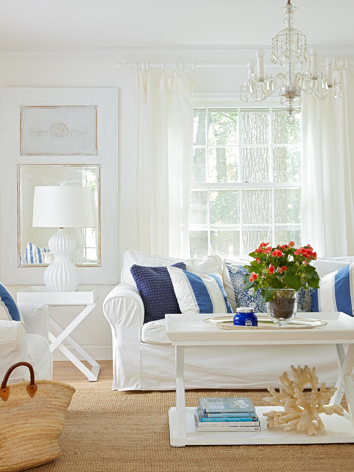 white living room with blue decorative pillows