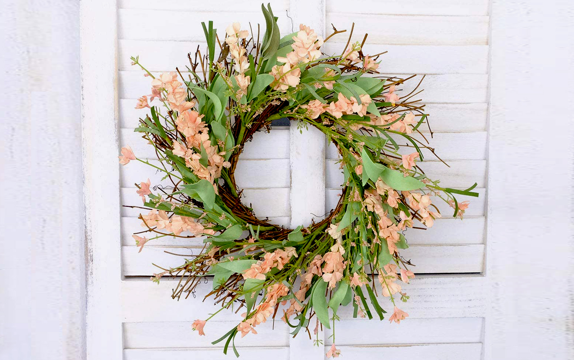 Spring wreath on a white door