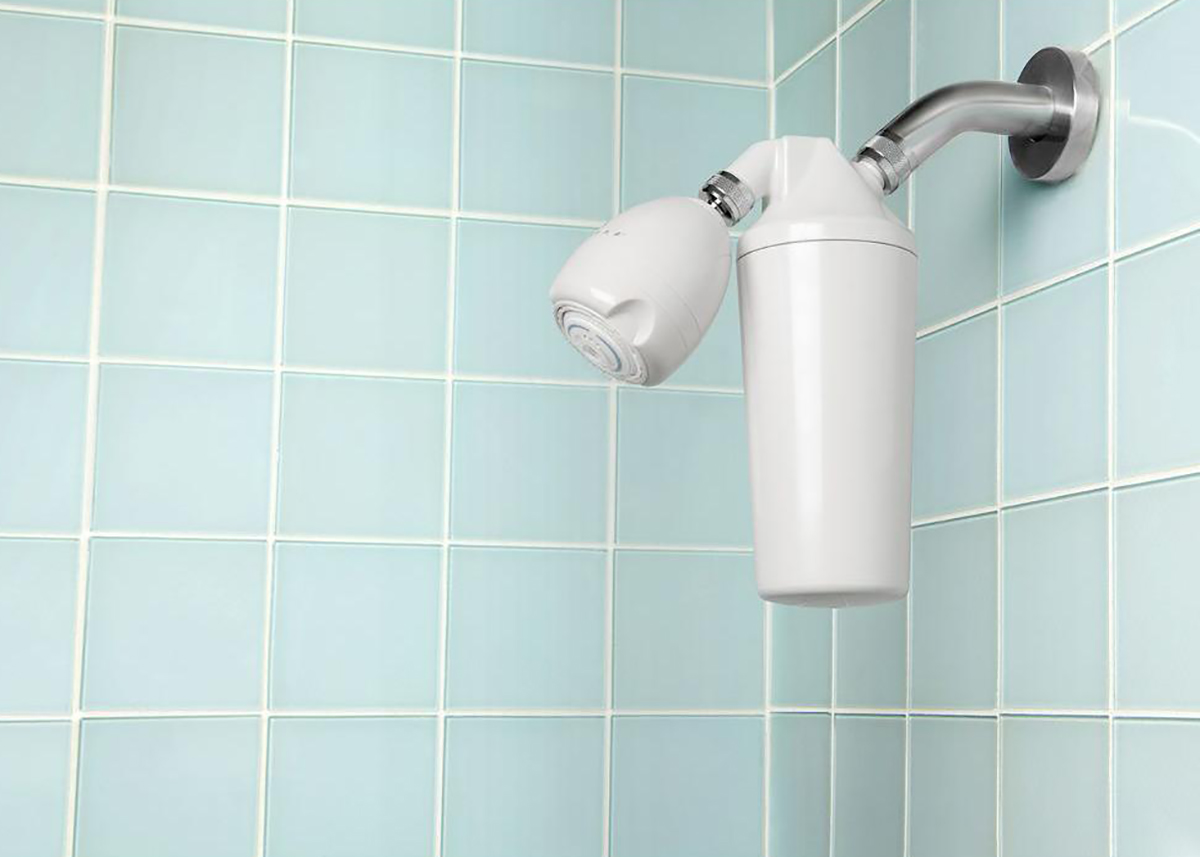 blue tiled shower with showerhead filter