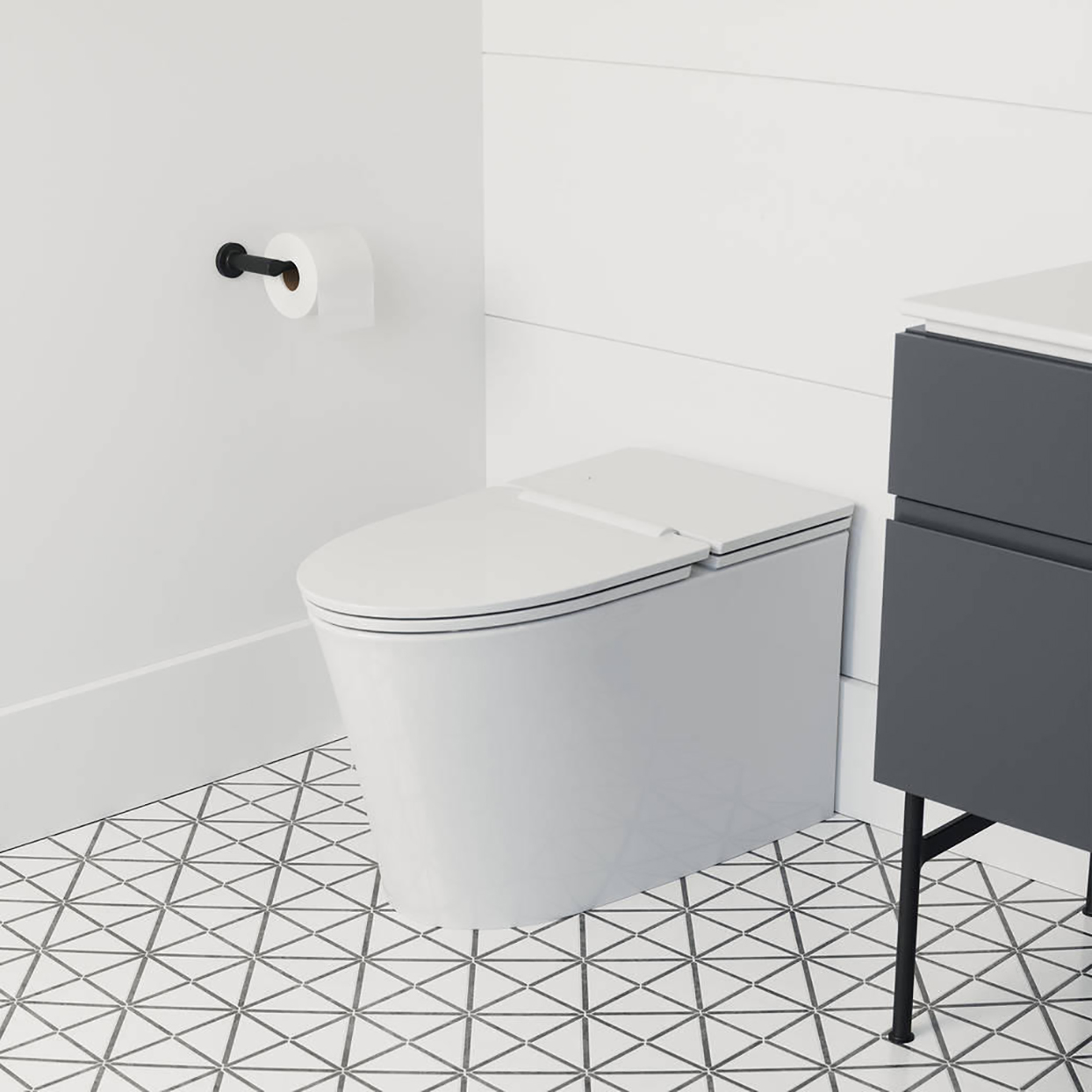 bathroom with contemporary toilet and geometric tile floor