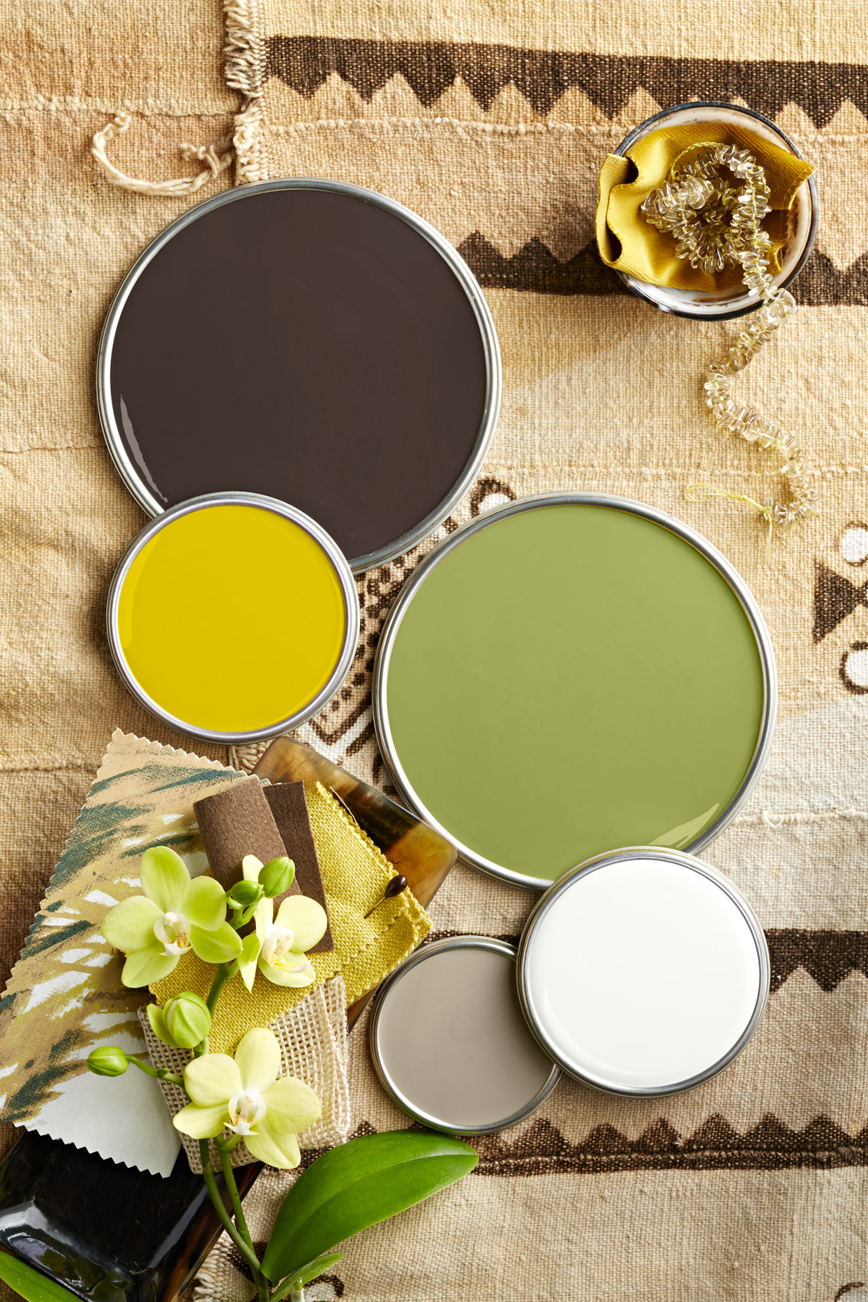 Green black and tan paint lids