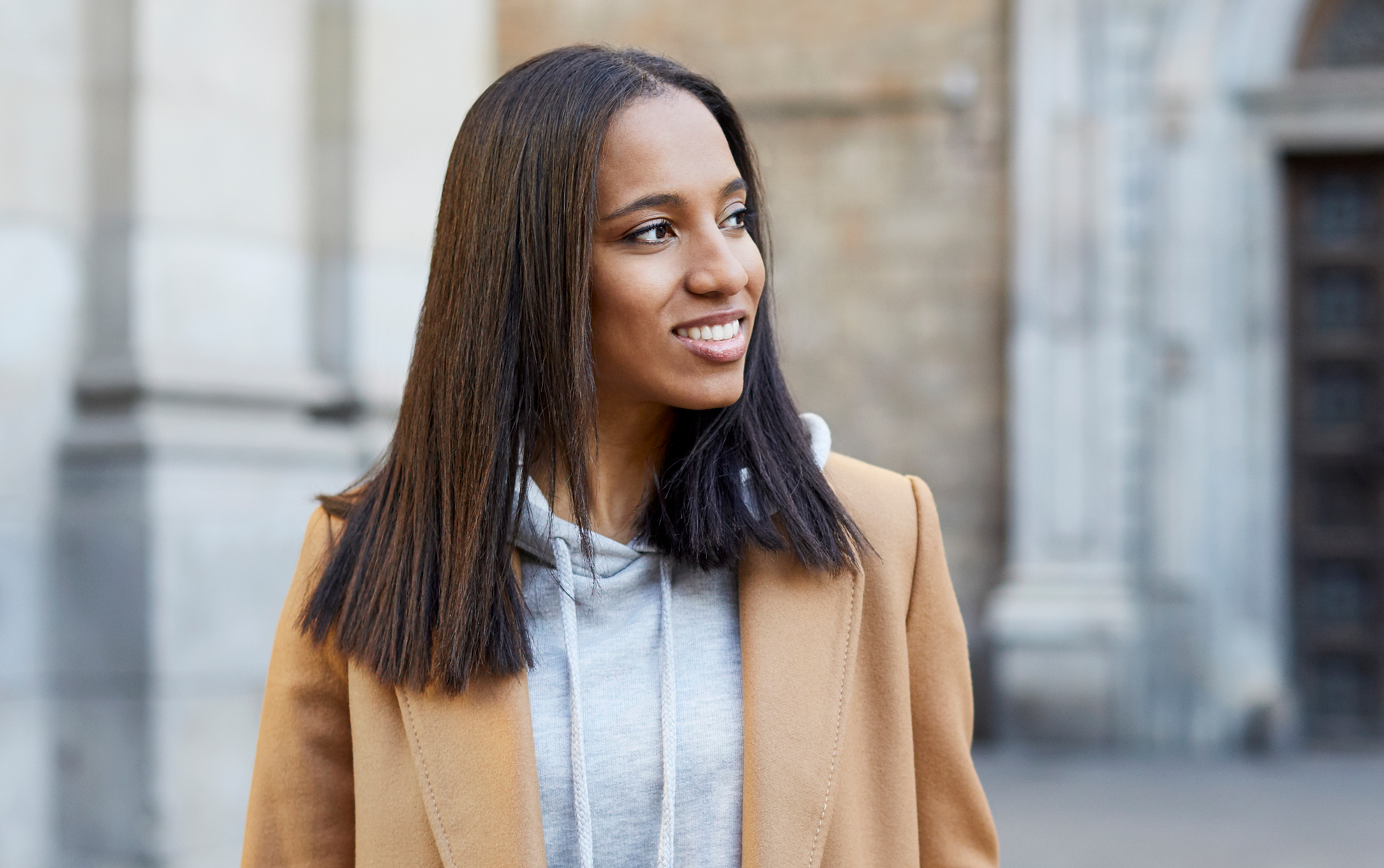 African American woman with straight hair outside