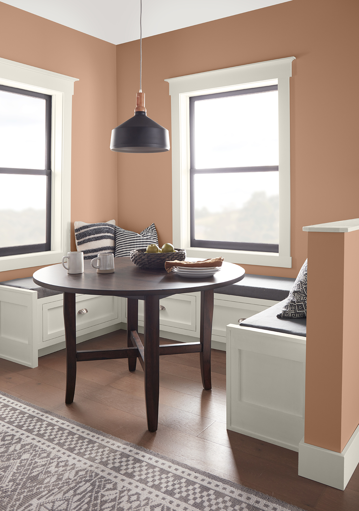 dining nook with terra-cotta walls