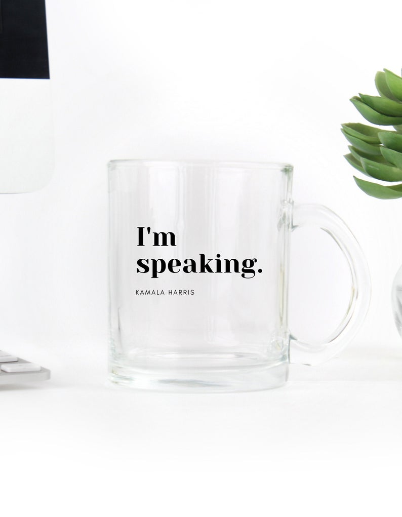 clear glass mug that says i'm speaking in black letters