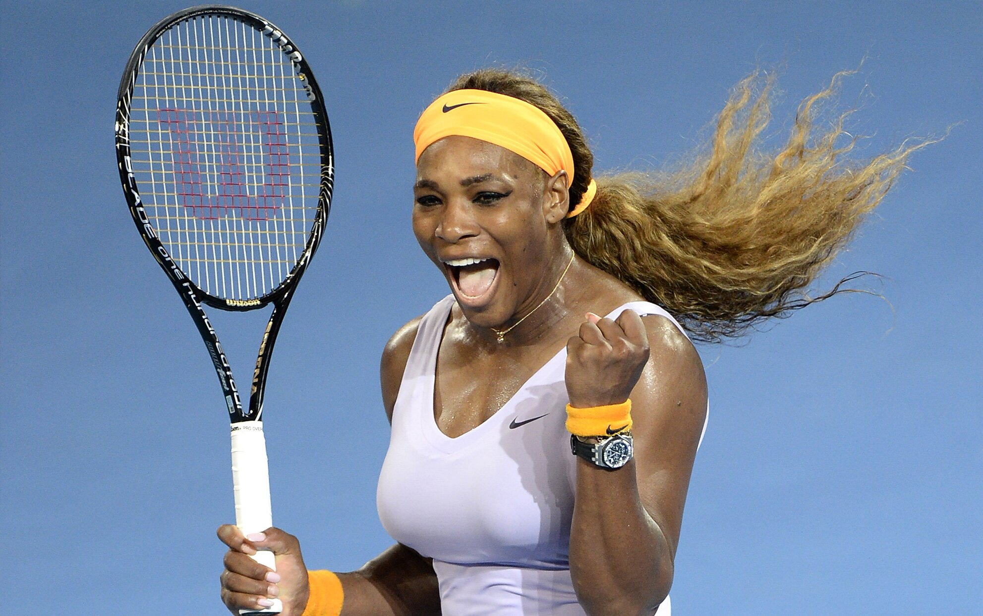 Serena Williams with a tennis racket on a blue background
