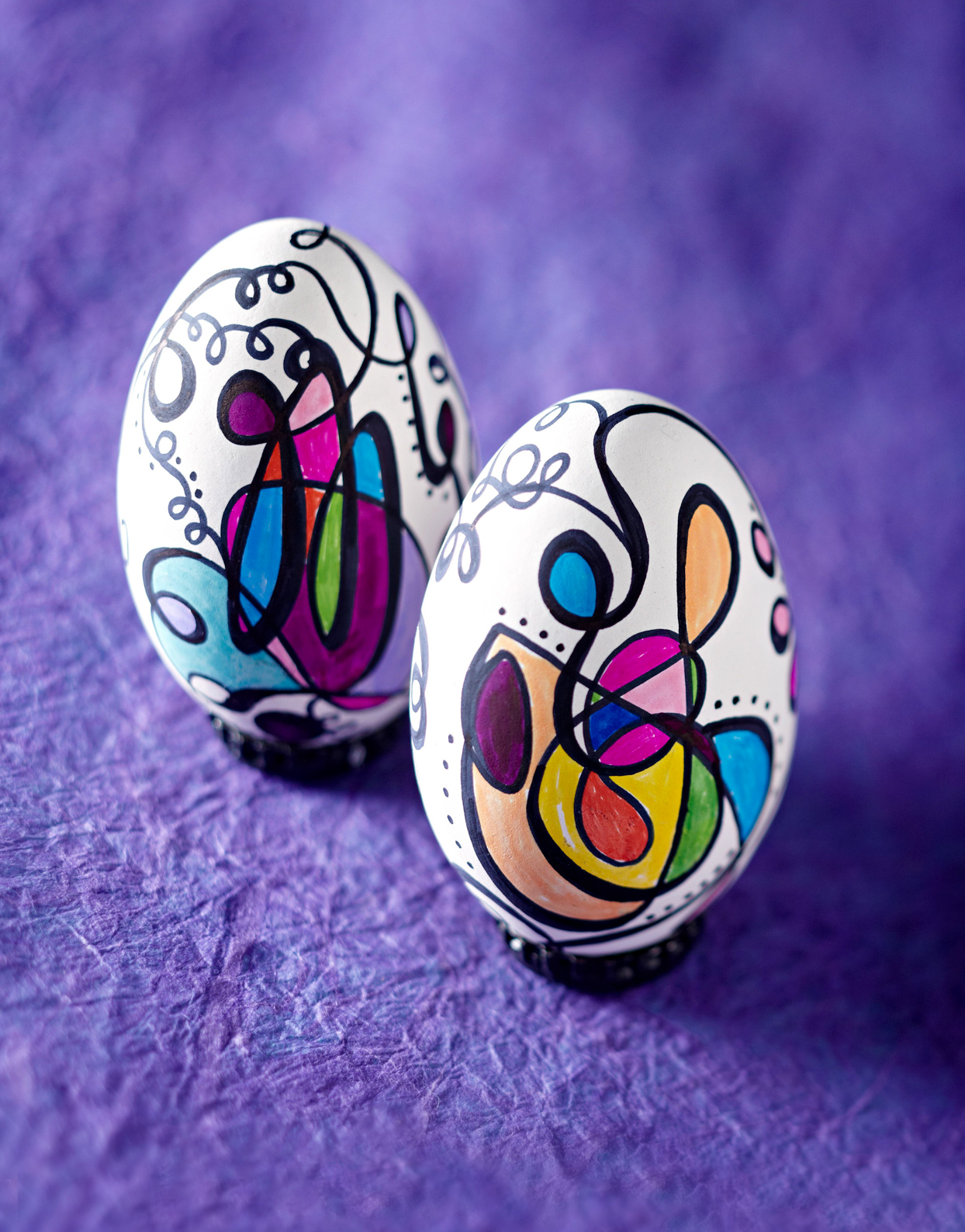abstract art easter eggs on purple