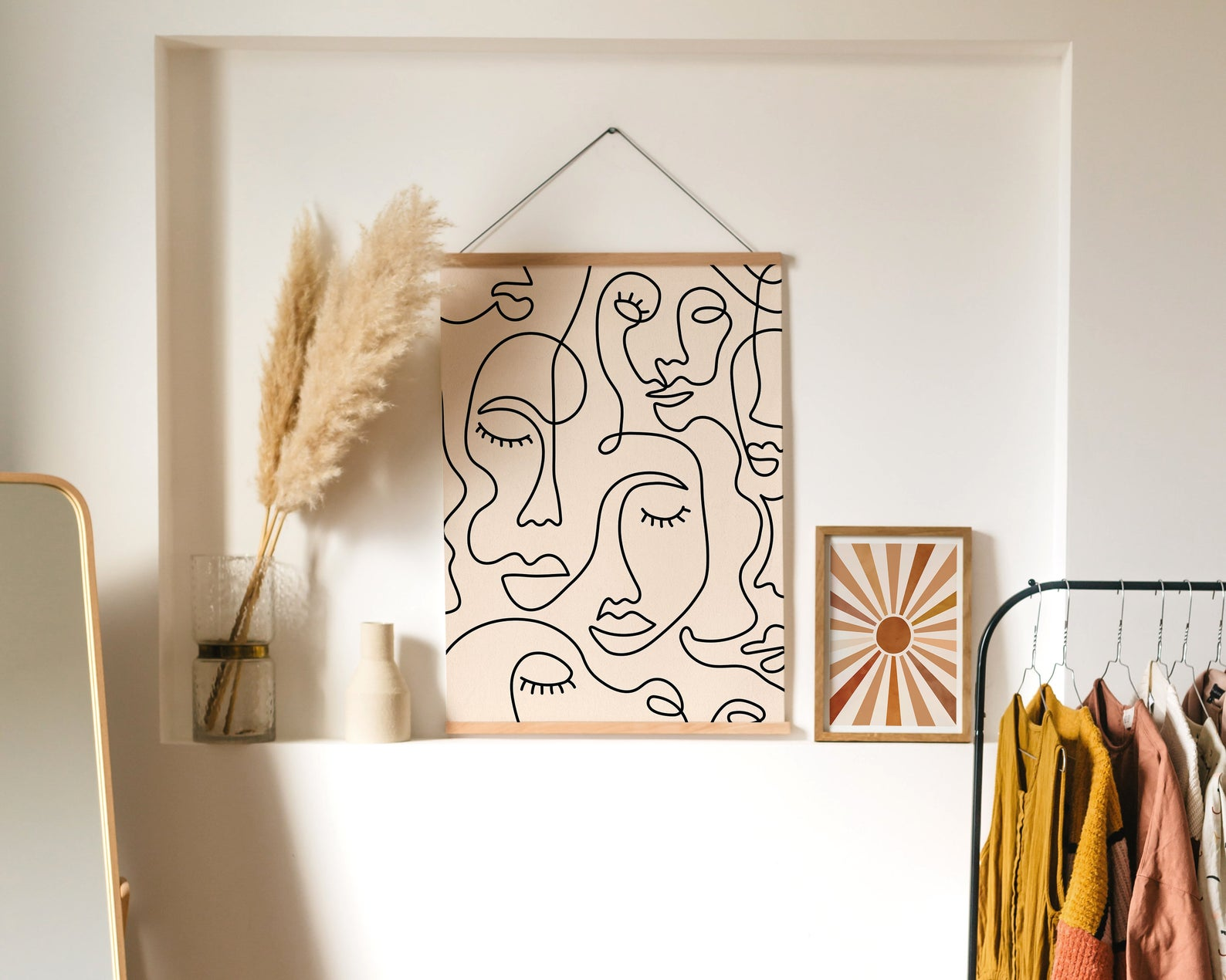 line art poster next to neutral vases and decor