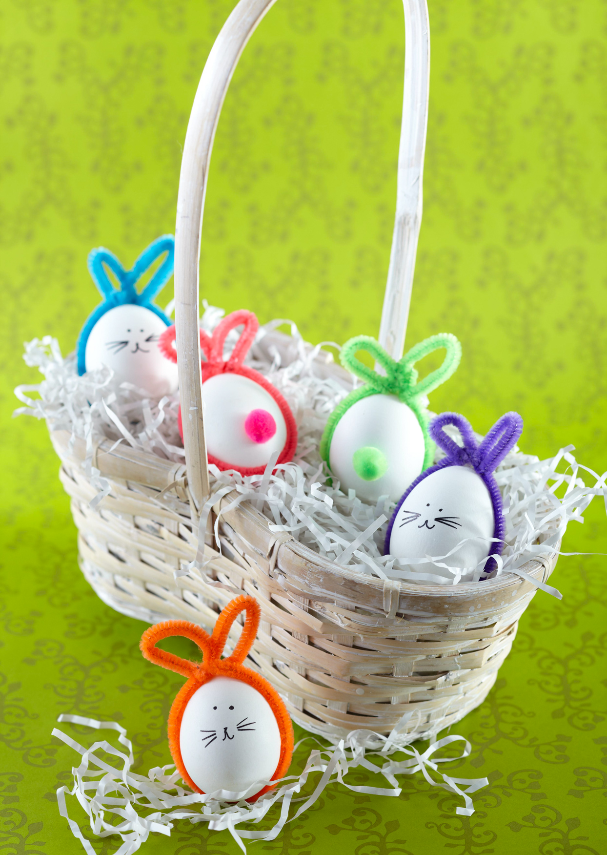 pipe cleaner bunny easter eggs in white basket