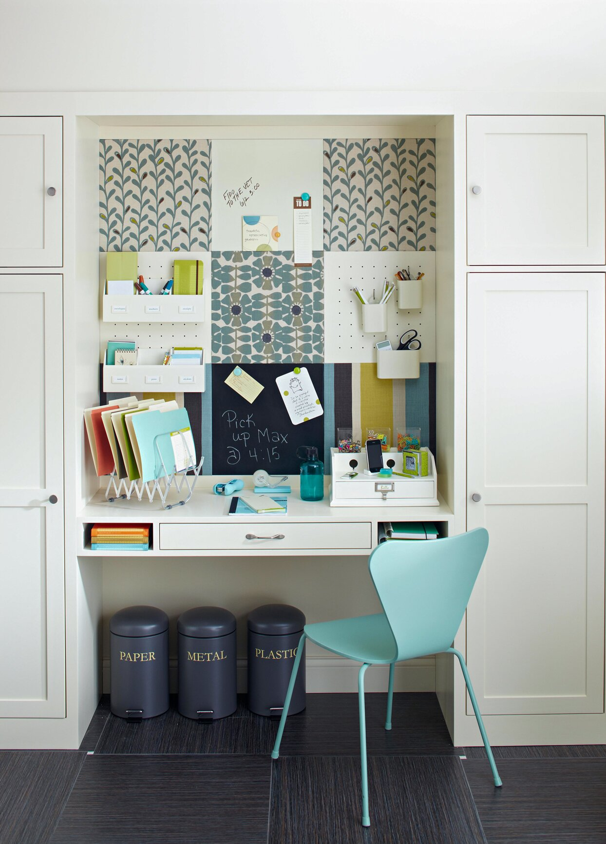 built-in desk office space white cabinets teal colored chair