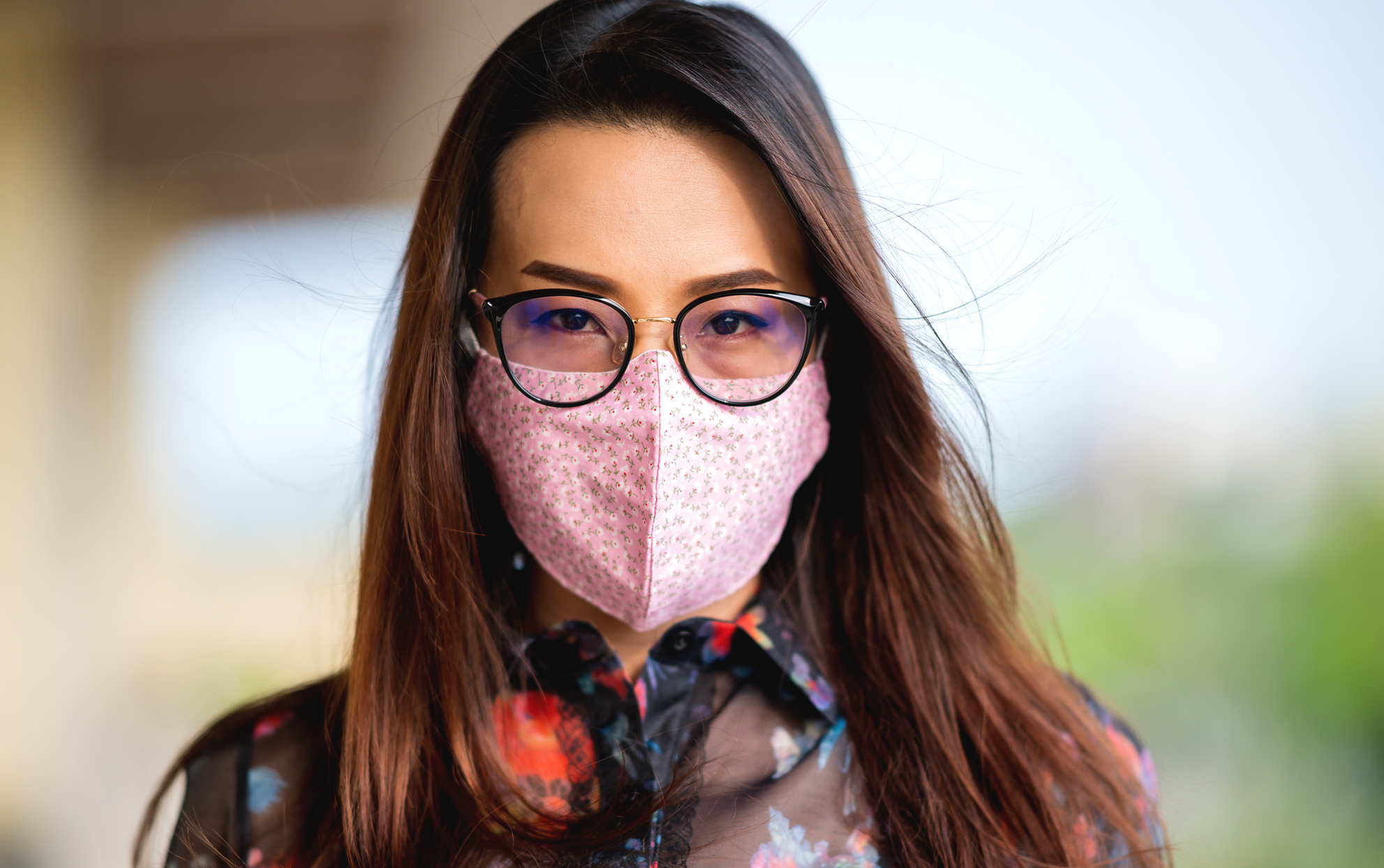 Asian woman wearing a pink face mask