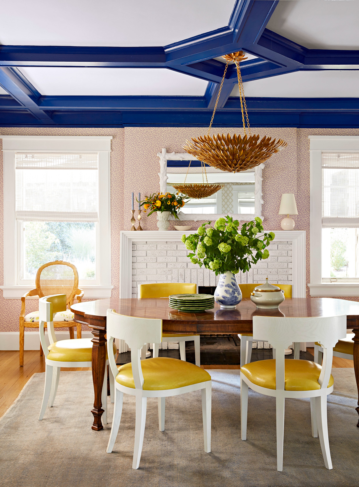 colorful dining room with deep blue ceiling and yellow accents