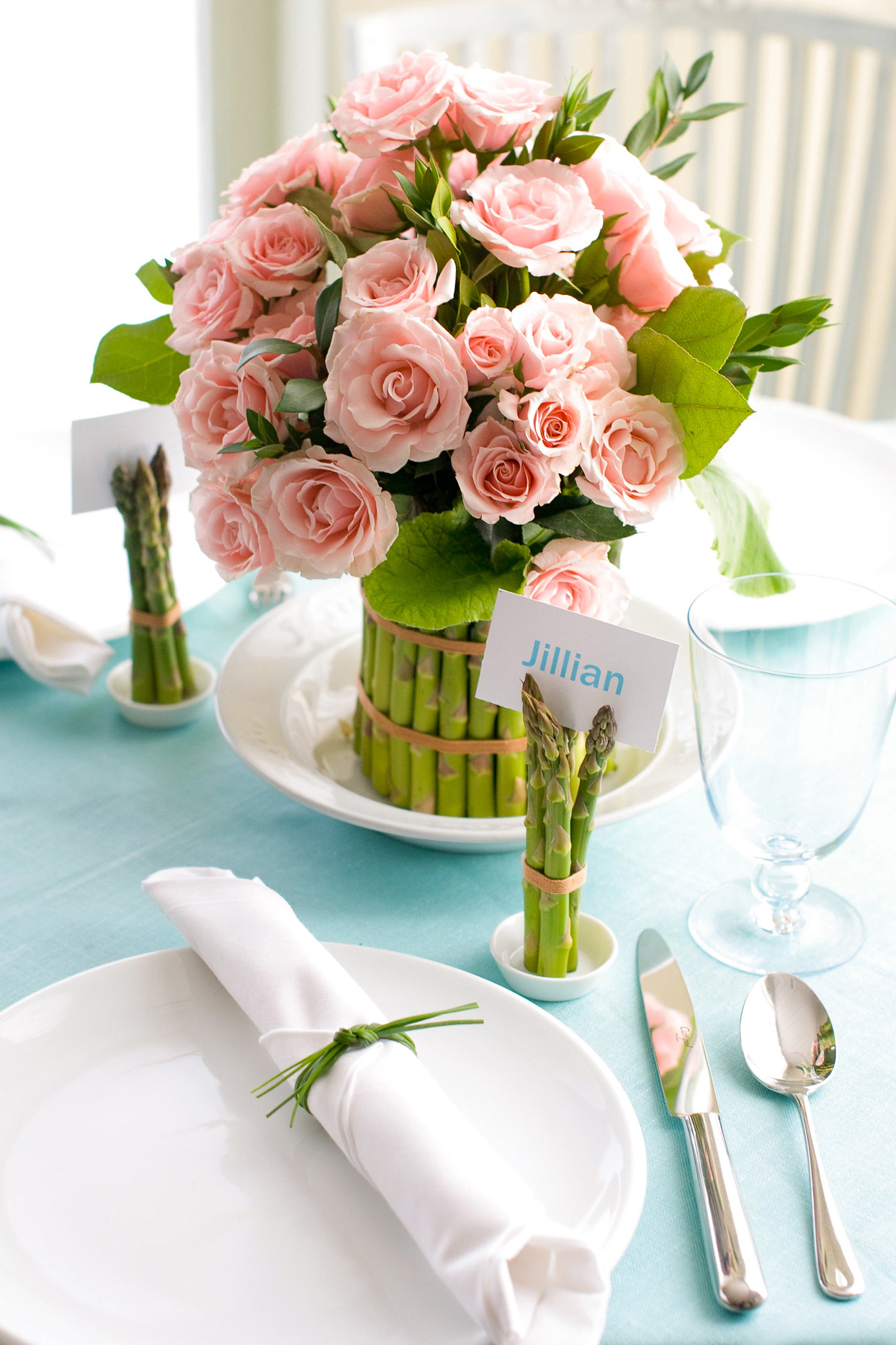 asparagus pink roses centerpiece place settings