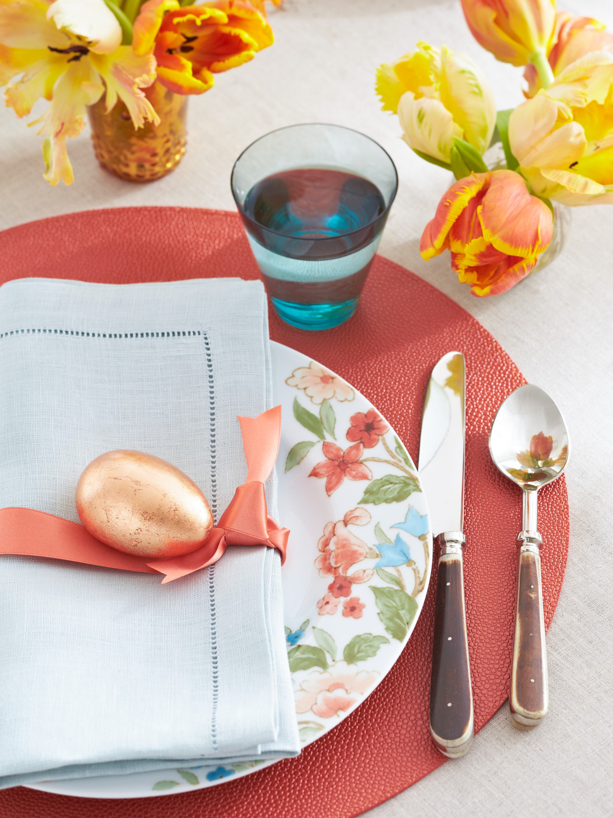 Easter place setting gold egg red floral accents