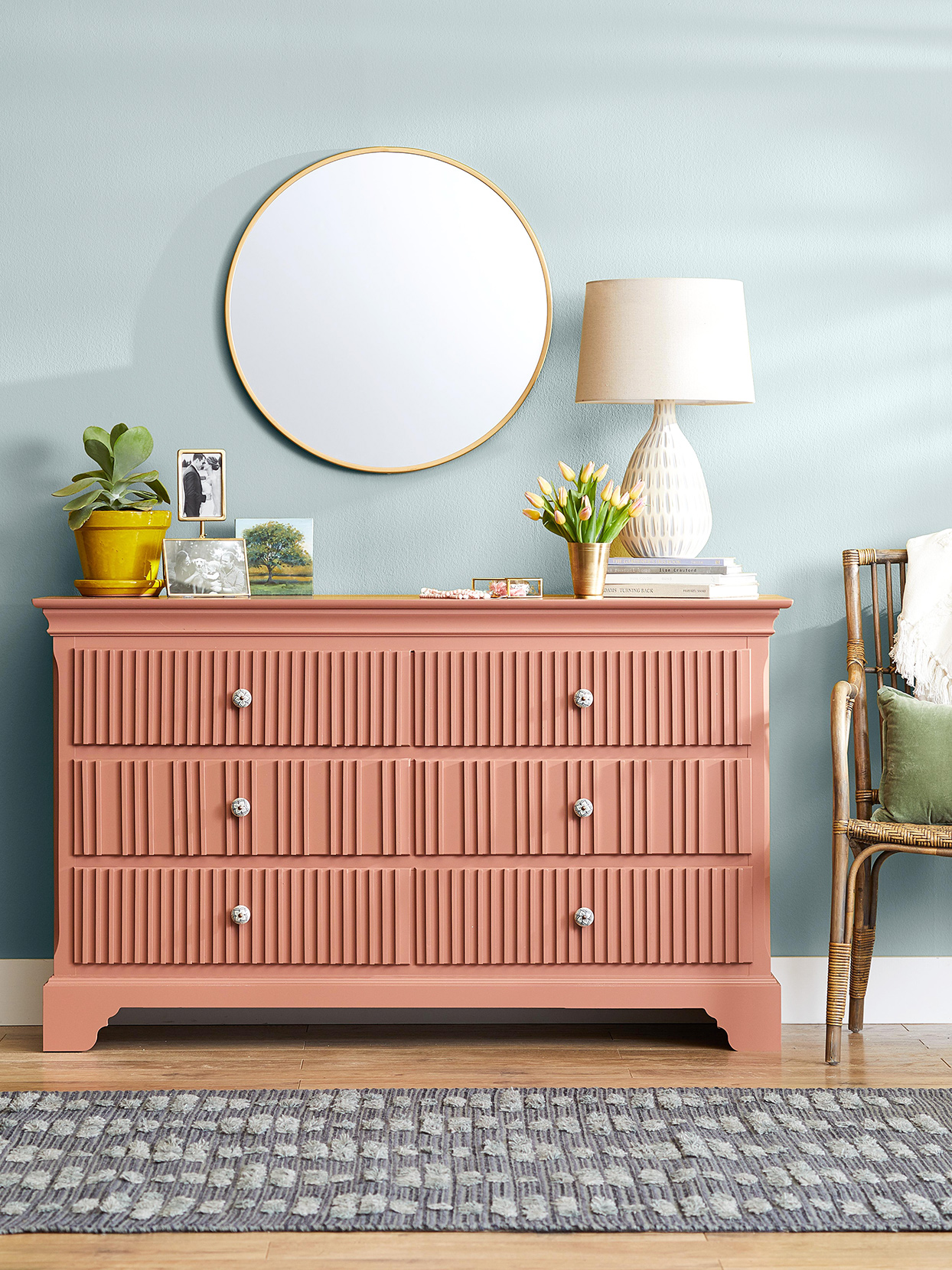 salmon pink dresser detailed drawers gold accents mirror