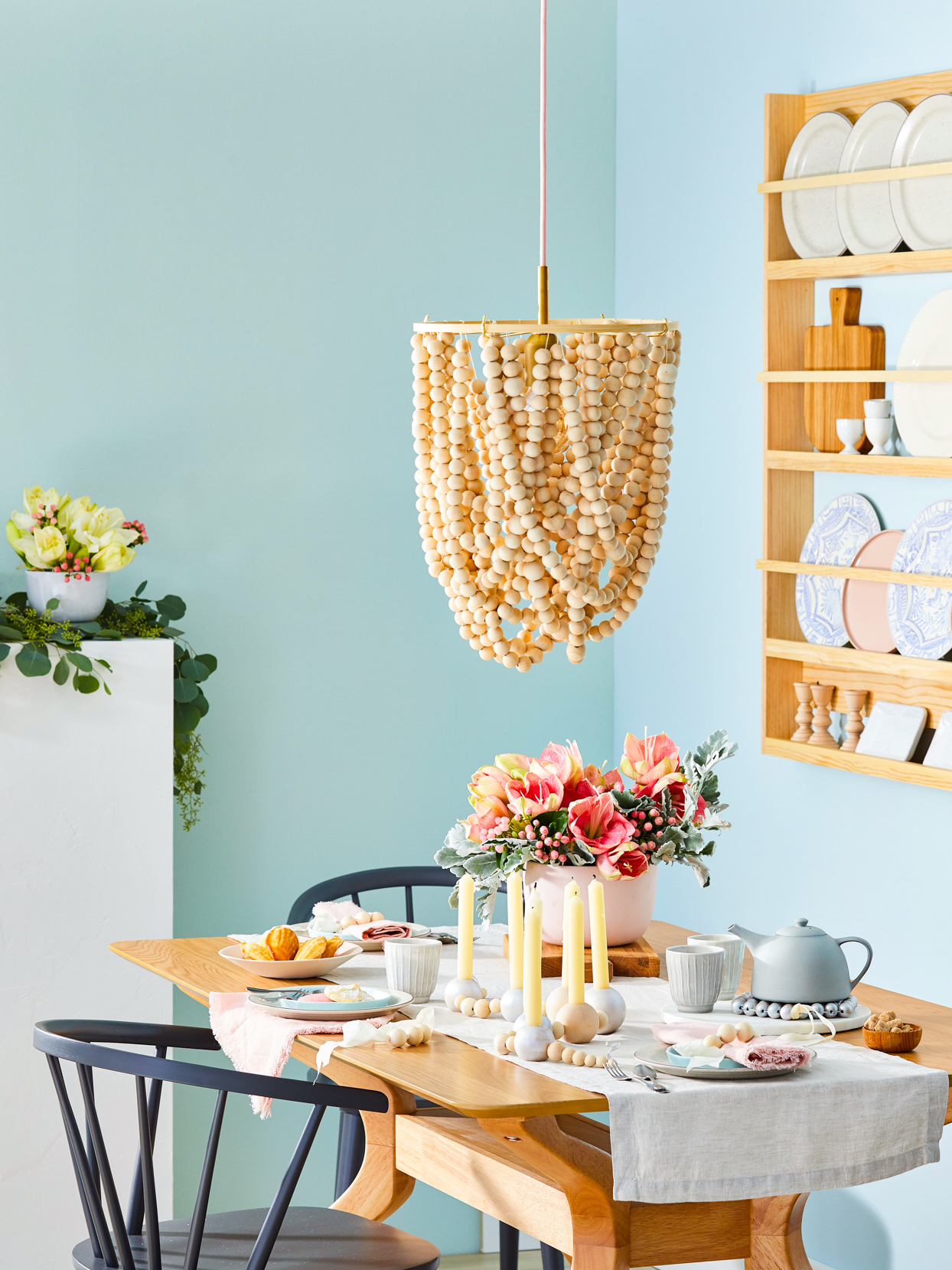 wooden chandelier hanging above table
