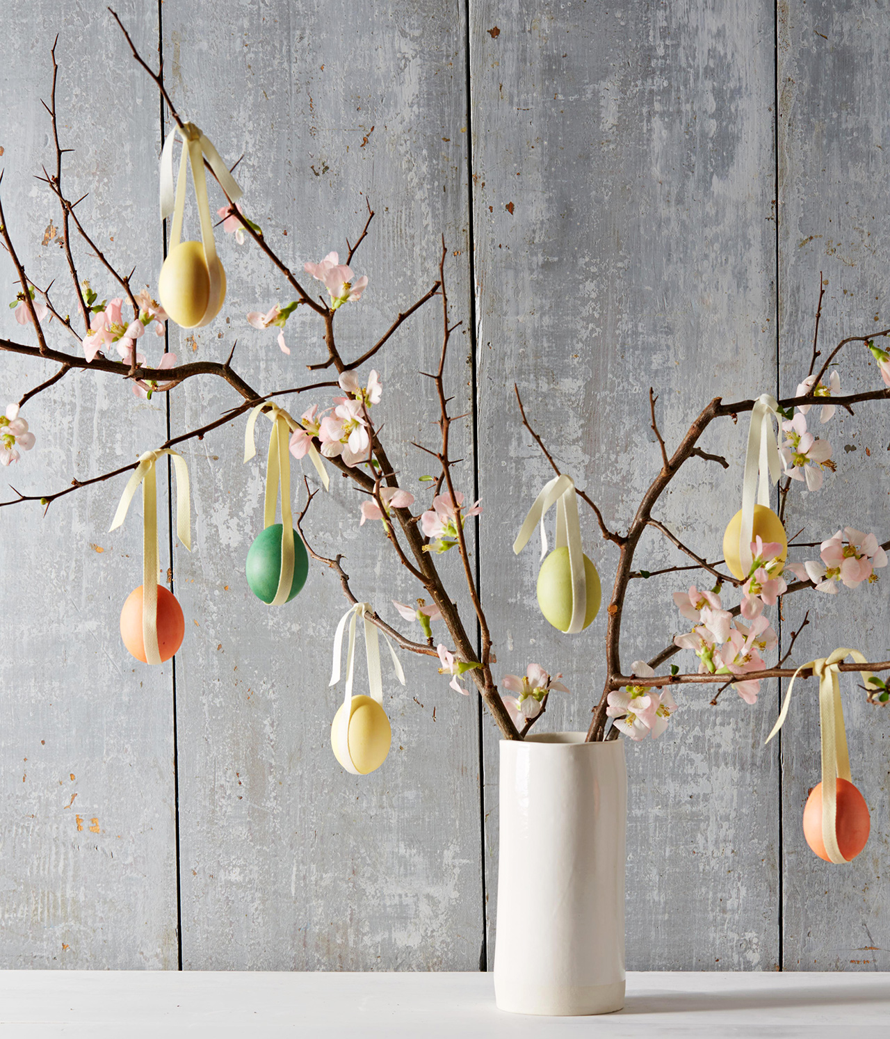 easter eggs hanging from branches