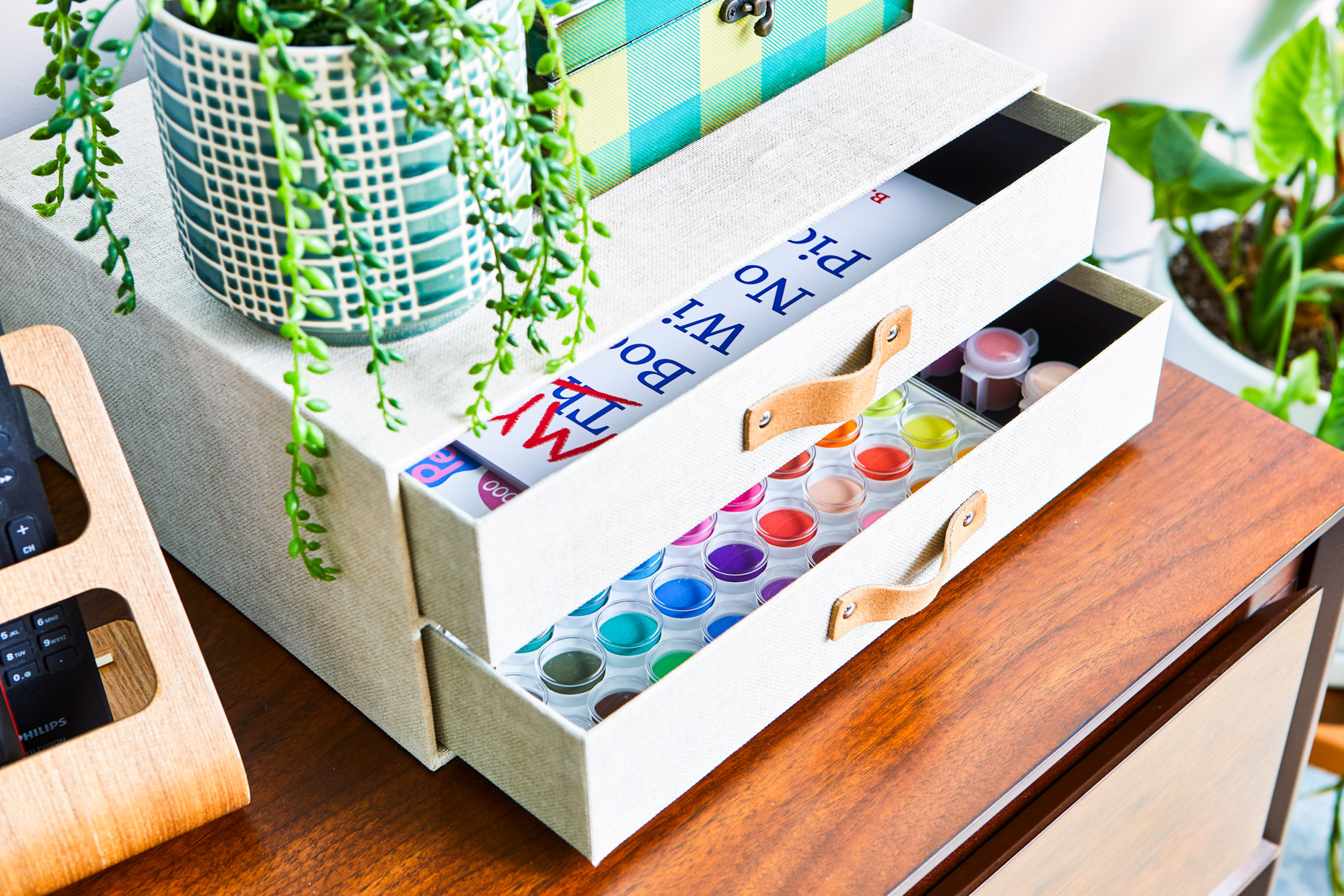 small white drawers with paints