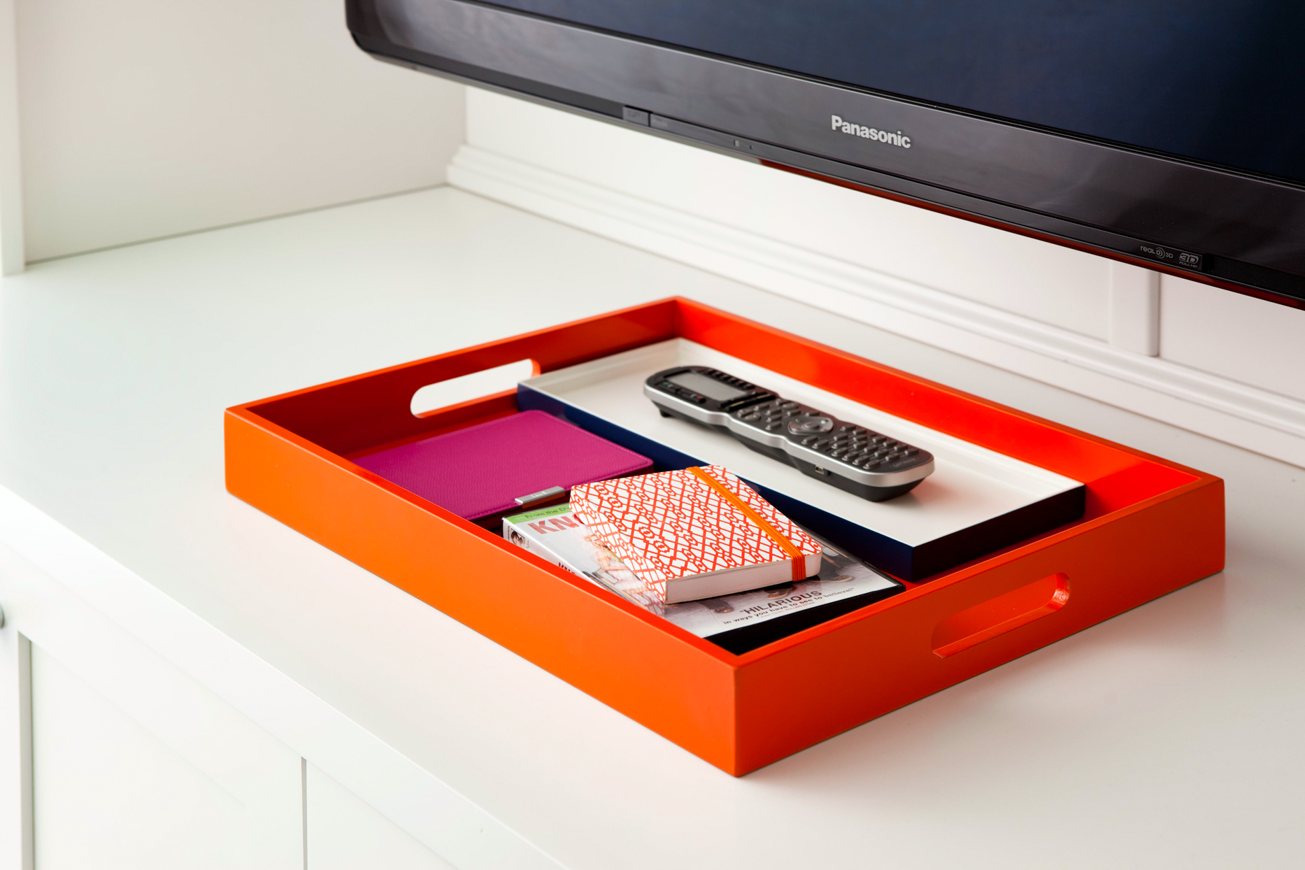 orange tray with remote and misc books