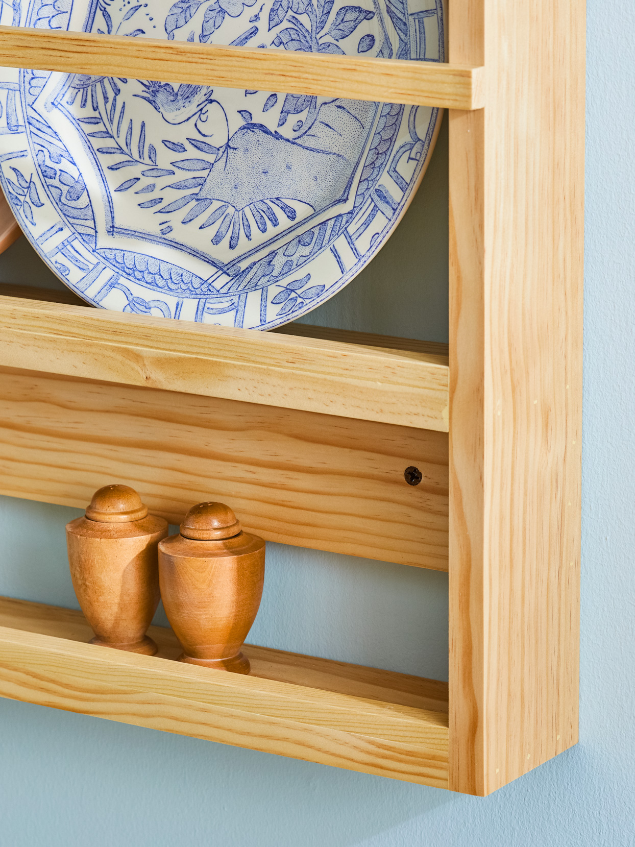glued nailed plate stops wood rack blue wall