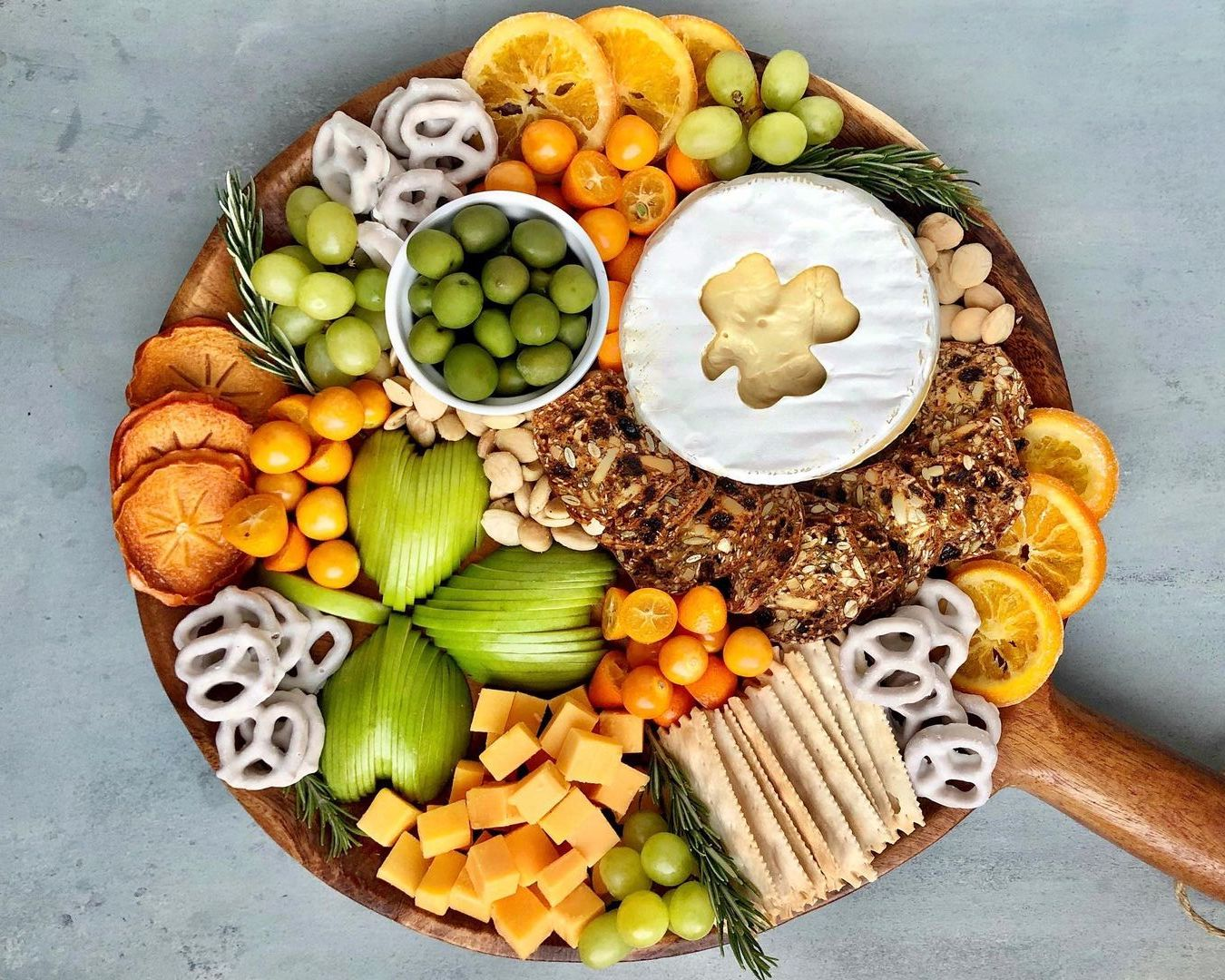 wood cheese board with shamrock shapes