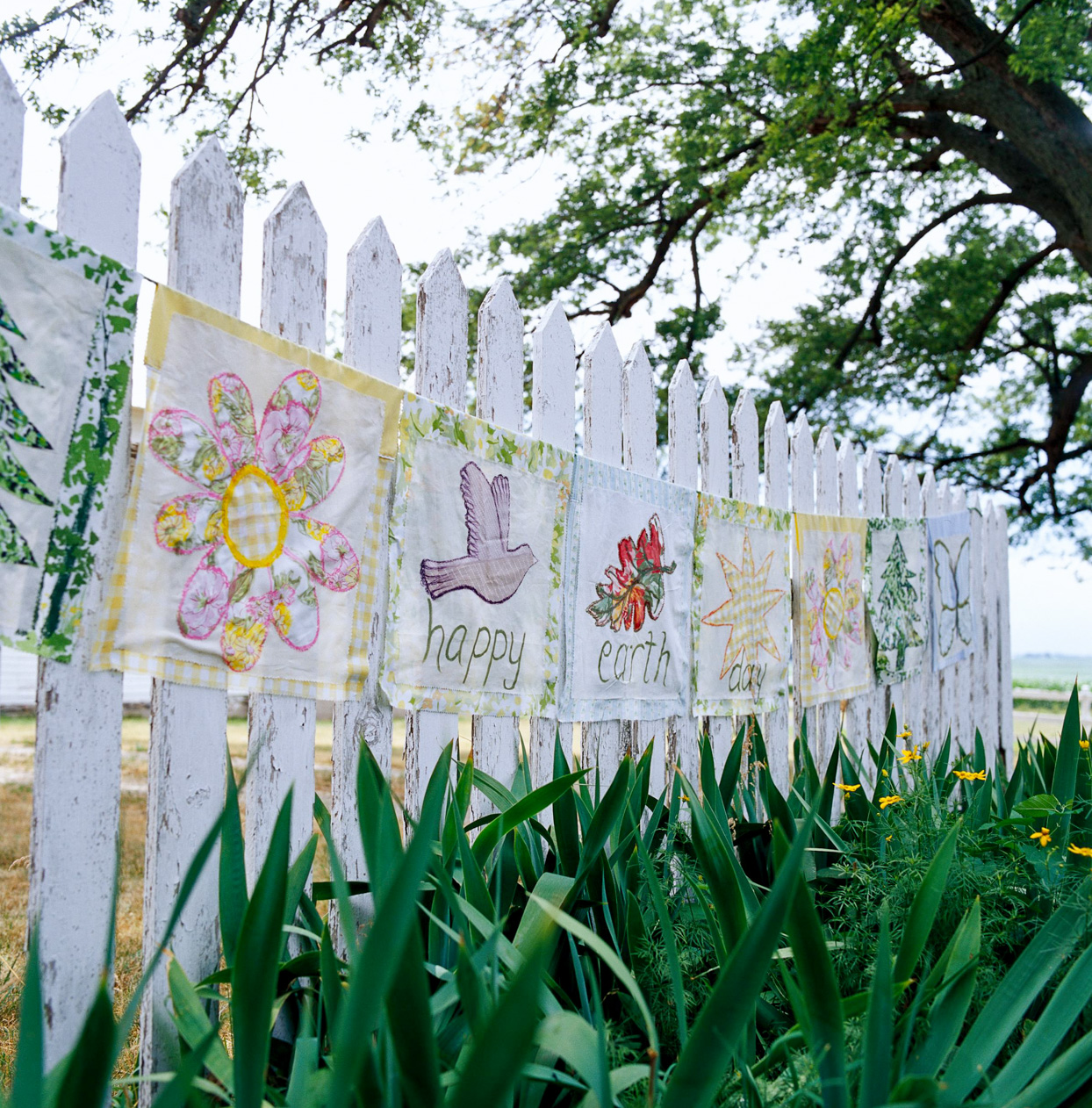 Earth Day Banner on picket fence