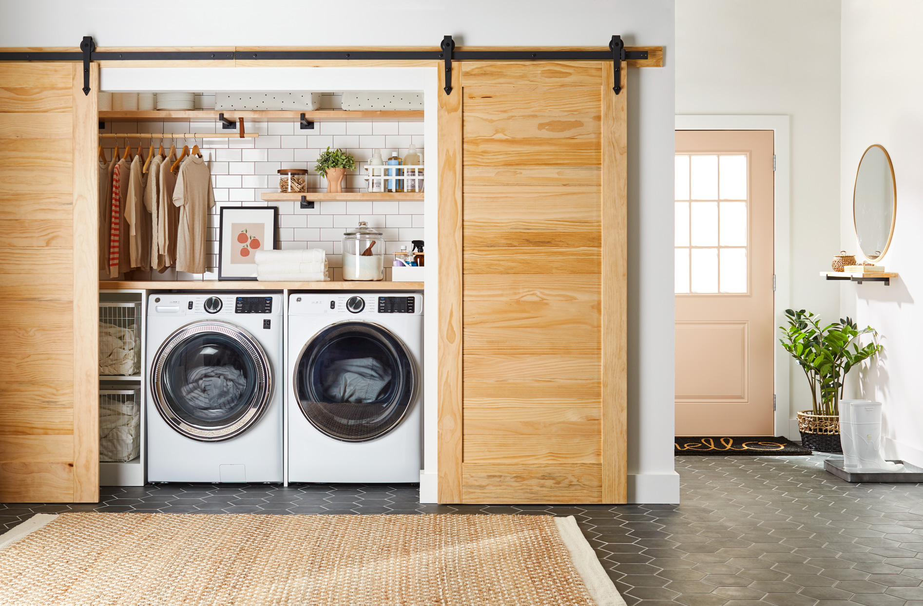 laundry room in closet with wooden barn doors