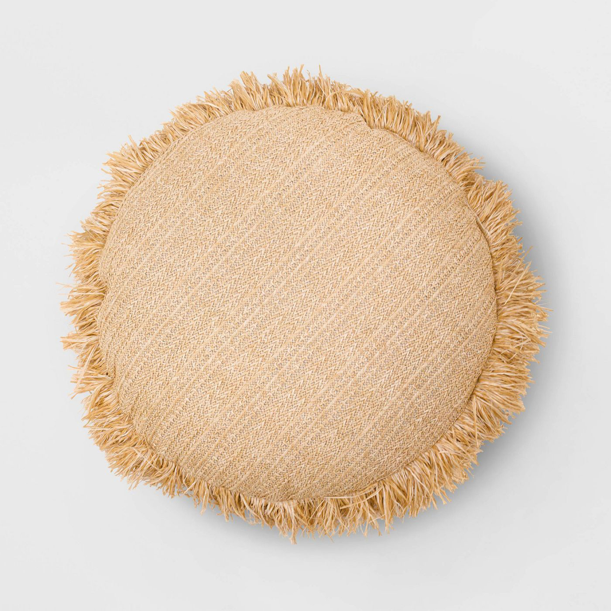 round outdoor pillow with woven material and fringe