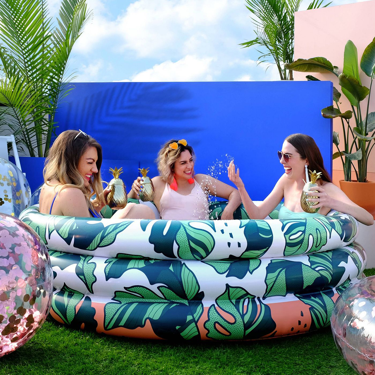 three women in inflatable pool