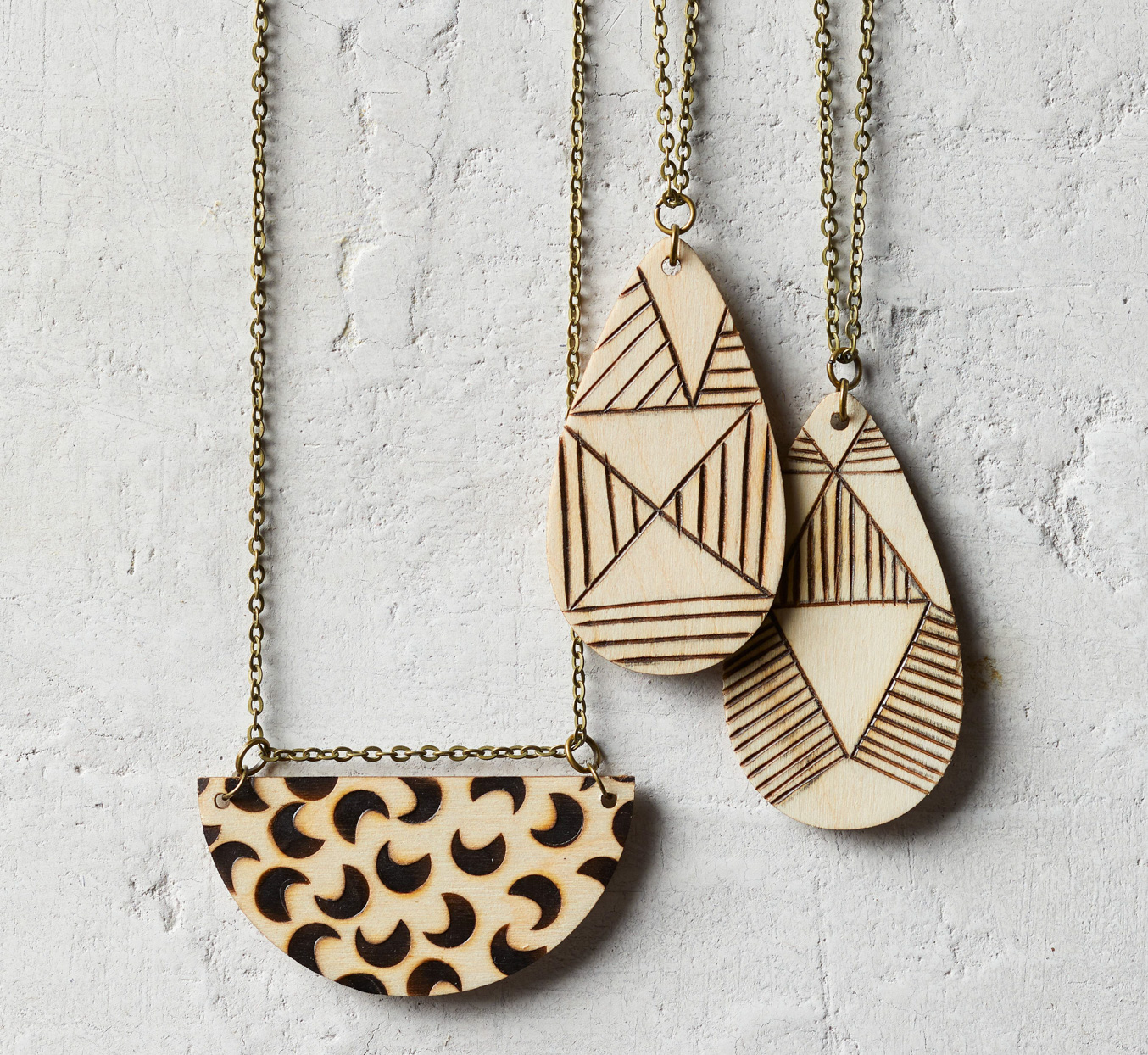 wooden carved necklaces on chains