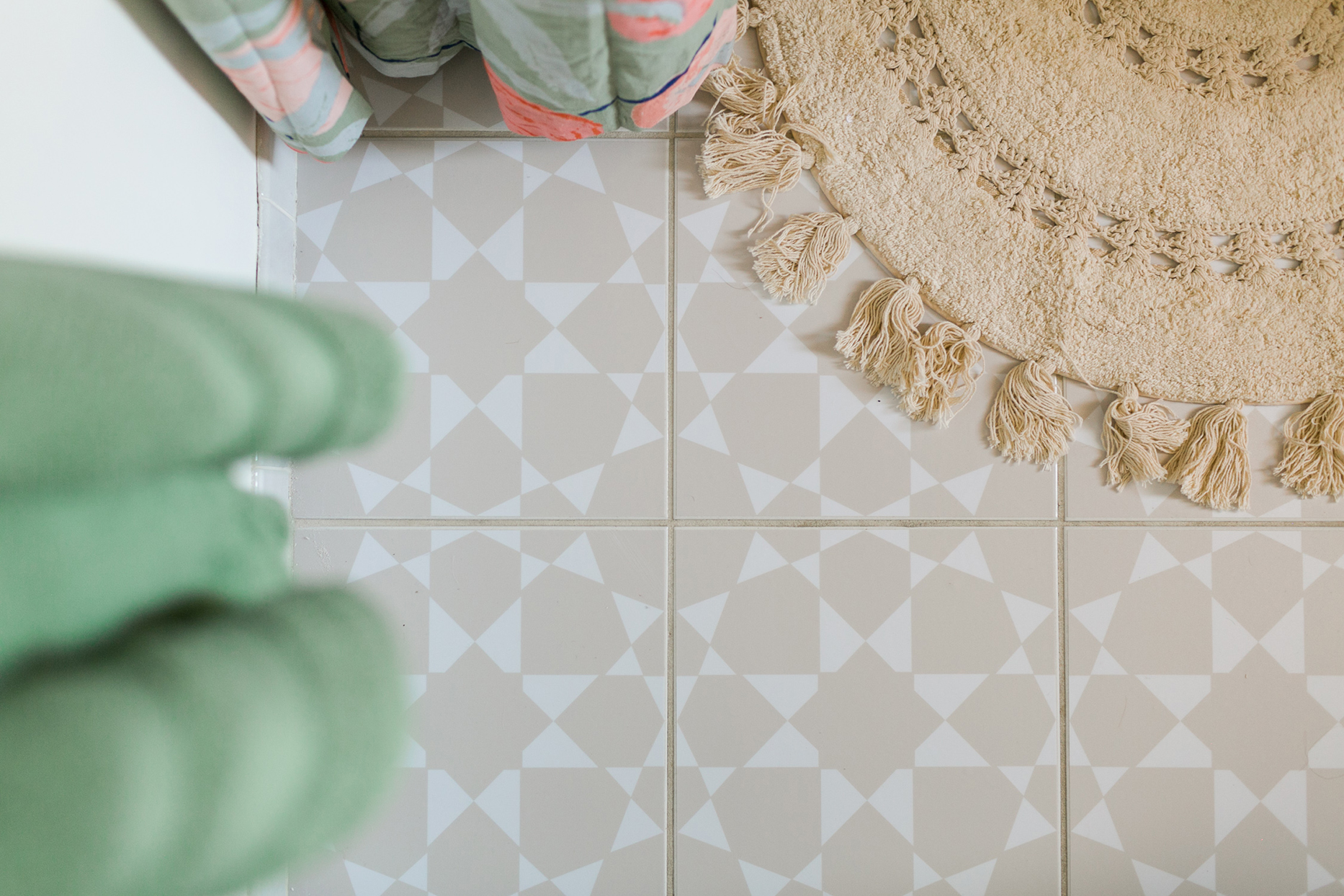 mauve and white patterned floor tile with woven rug