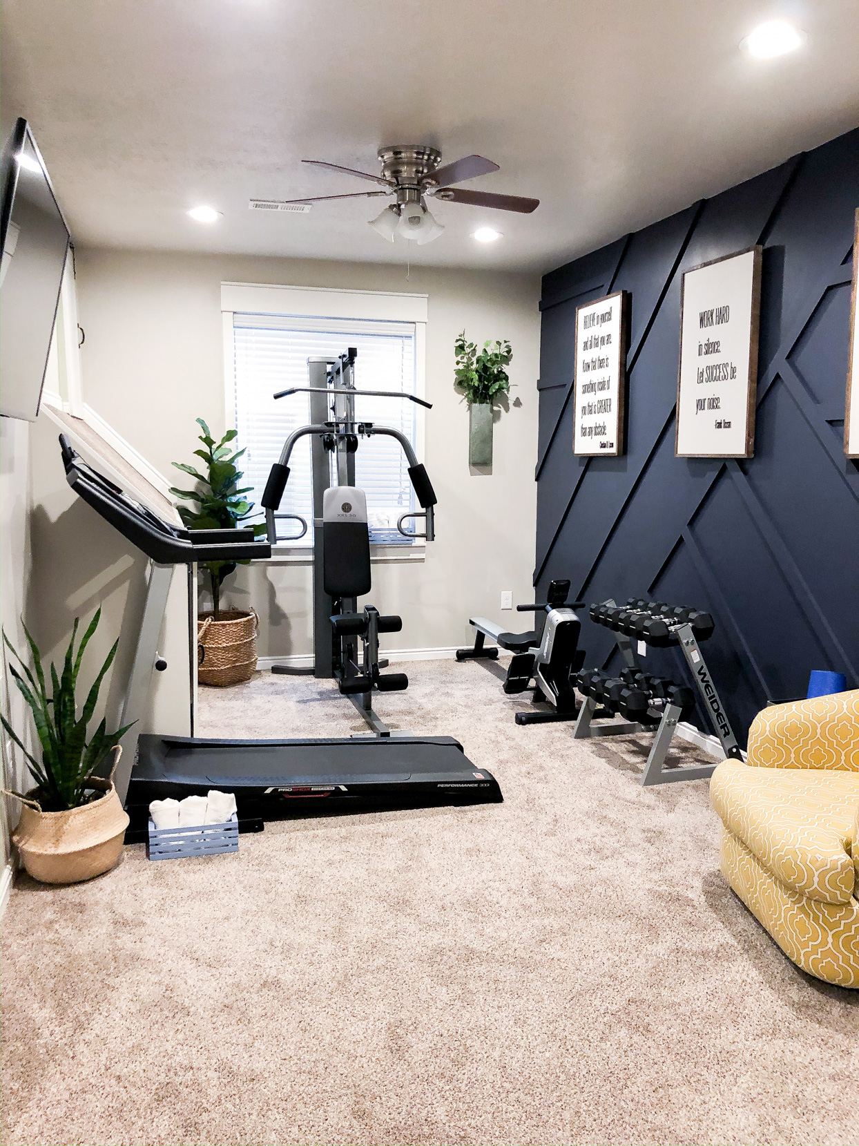 home gym with black textured wall