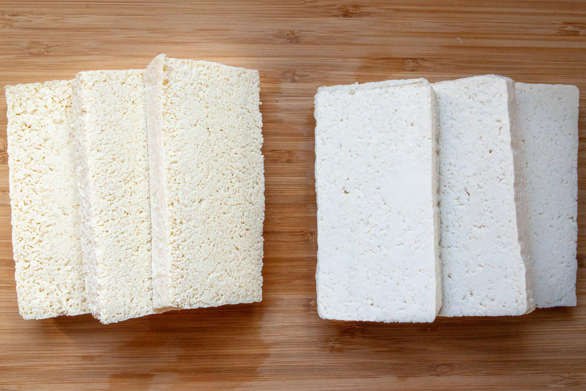 slices of tofu on a wood cutting board