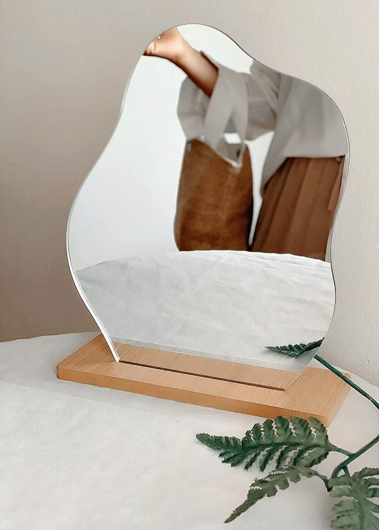 frameless squiggly mirror with wood base