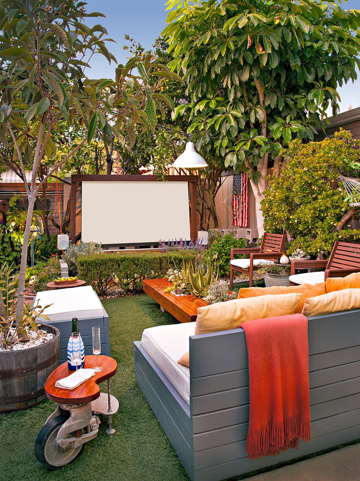 projector screen outdoor movie night tropical backyard oasis furniture
