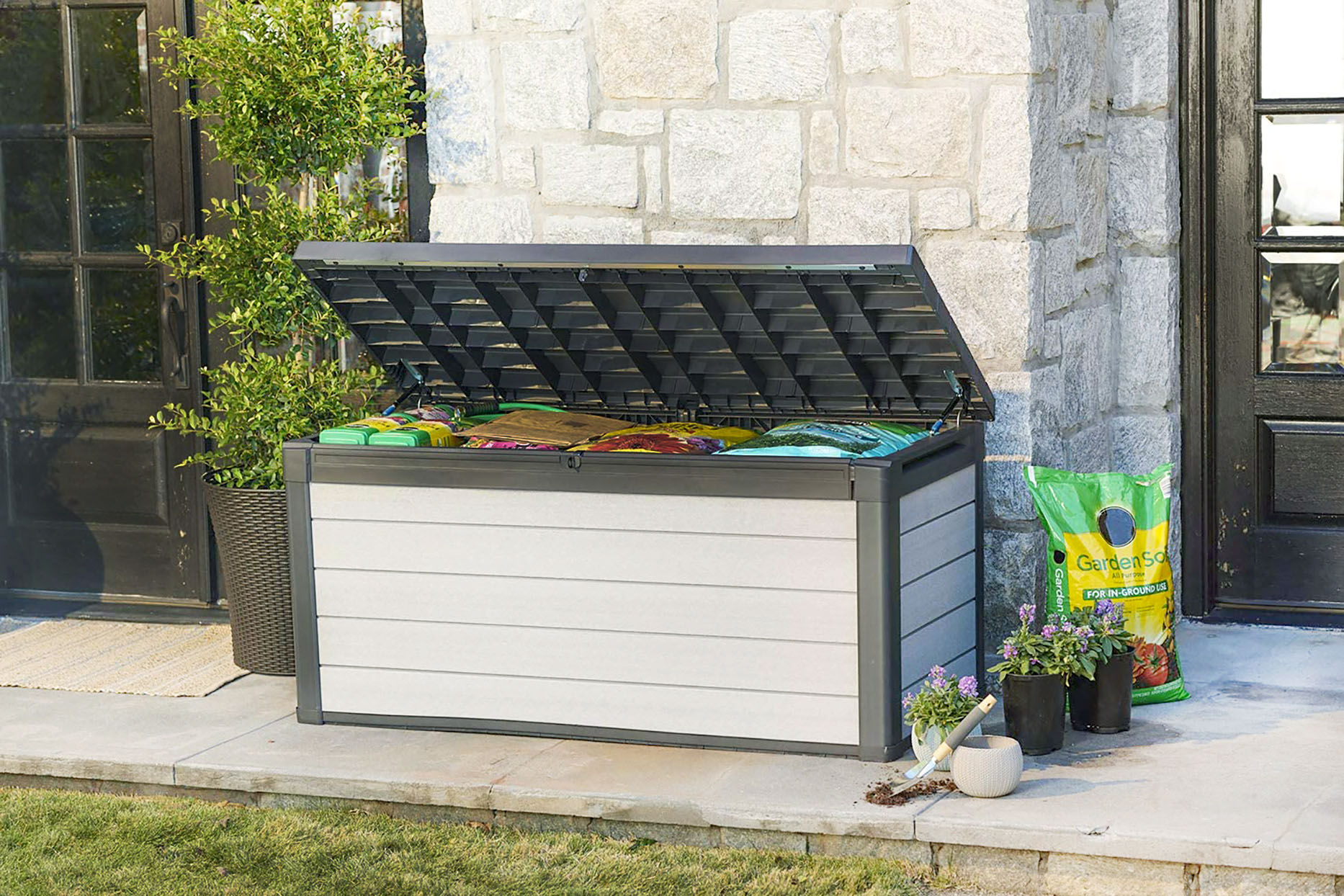outdoor storage bench holding gardening supplies